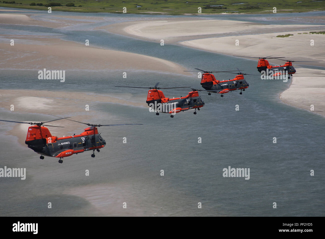 A flight of four HH-46D Seaknight helicopters make one of their final formation flights over North Carolina's Outer Banks in August 2015, weeks before the Marine Corps turned the aircraft over to the Navy as the Corps' ended its search and rescue mission.  The helicopters were a familiar sight in Eastern North Carolina skies for decades as Marine Transport Squadron 1 conducted SAR and medical transport flights for both military and civilian emergencies, including the rescue of 399 people directly threatened by flood after Hurricane Floyd washed through eastern North Carolina in September 1999. - Stock Image