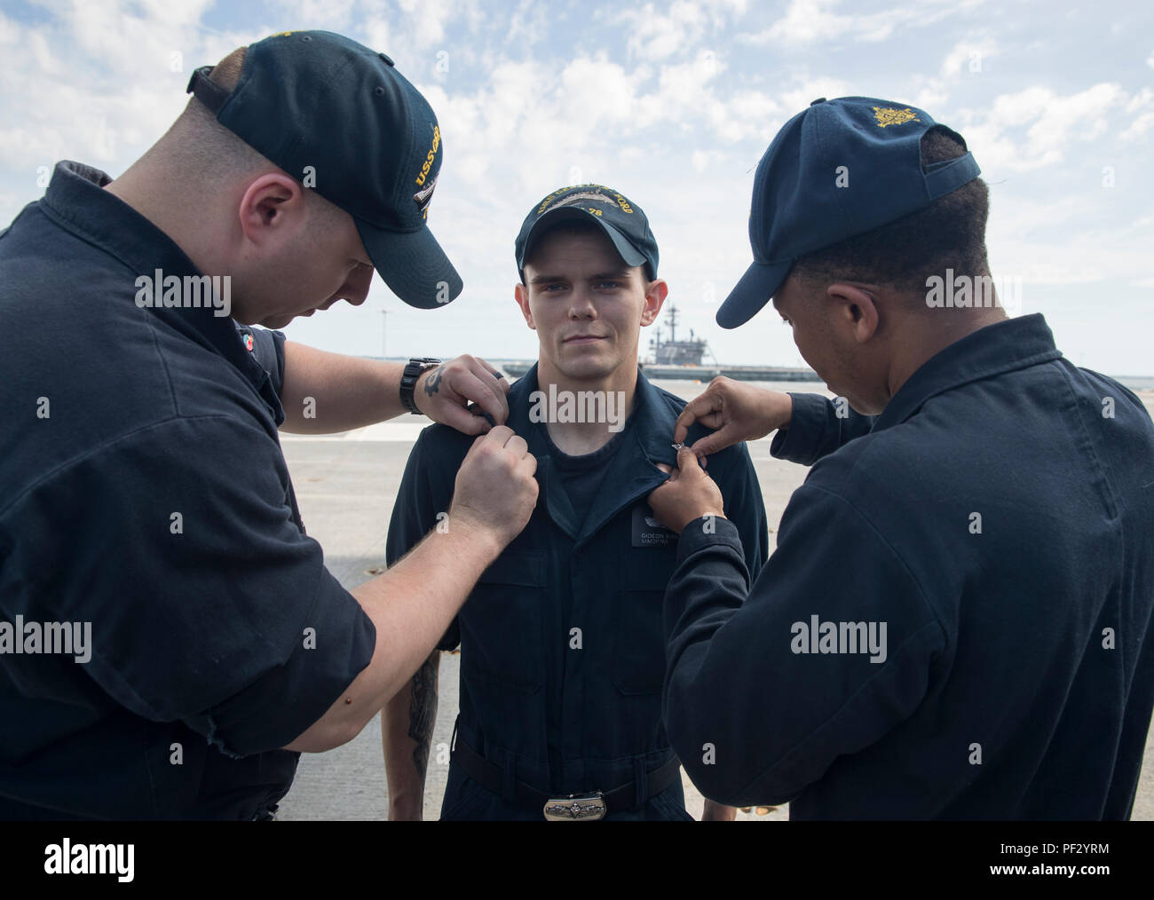 NORFOLK, Va. (June 15, 2018) - Machinist Mate (Nuclear) 2nd Class Gideon Kirkpatrick, from Christopher, Illinois, assigned to USS Gerald R. Ford's (CVN 78) reactor department, is pinned to his current rank during a promotion ceremony on the ship's flight deck. (U.S. Navy photo by Mass Communication Specialist 2nd Class Kiana A. Raines) - Stock Image