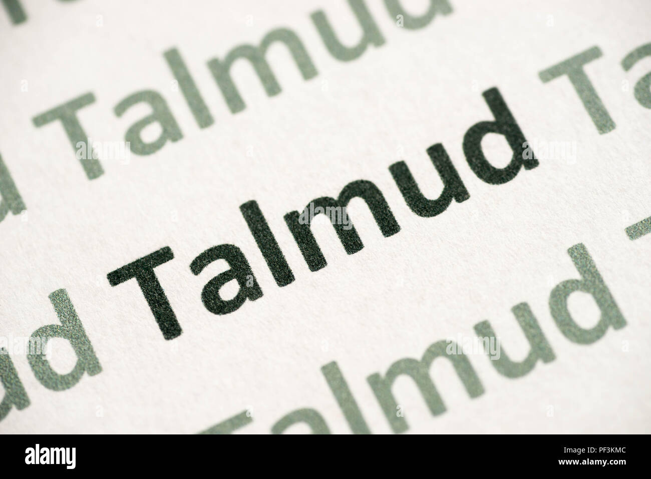 word Talmud printed on white paper macro - Stock Image