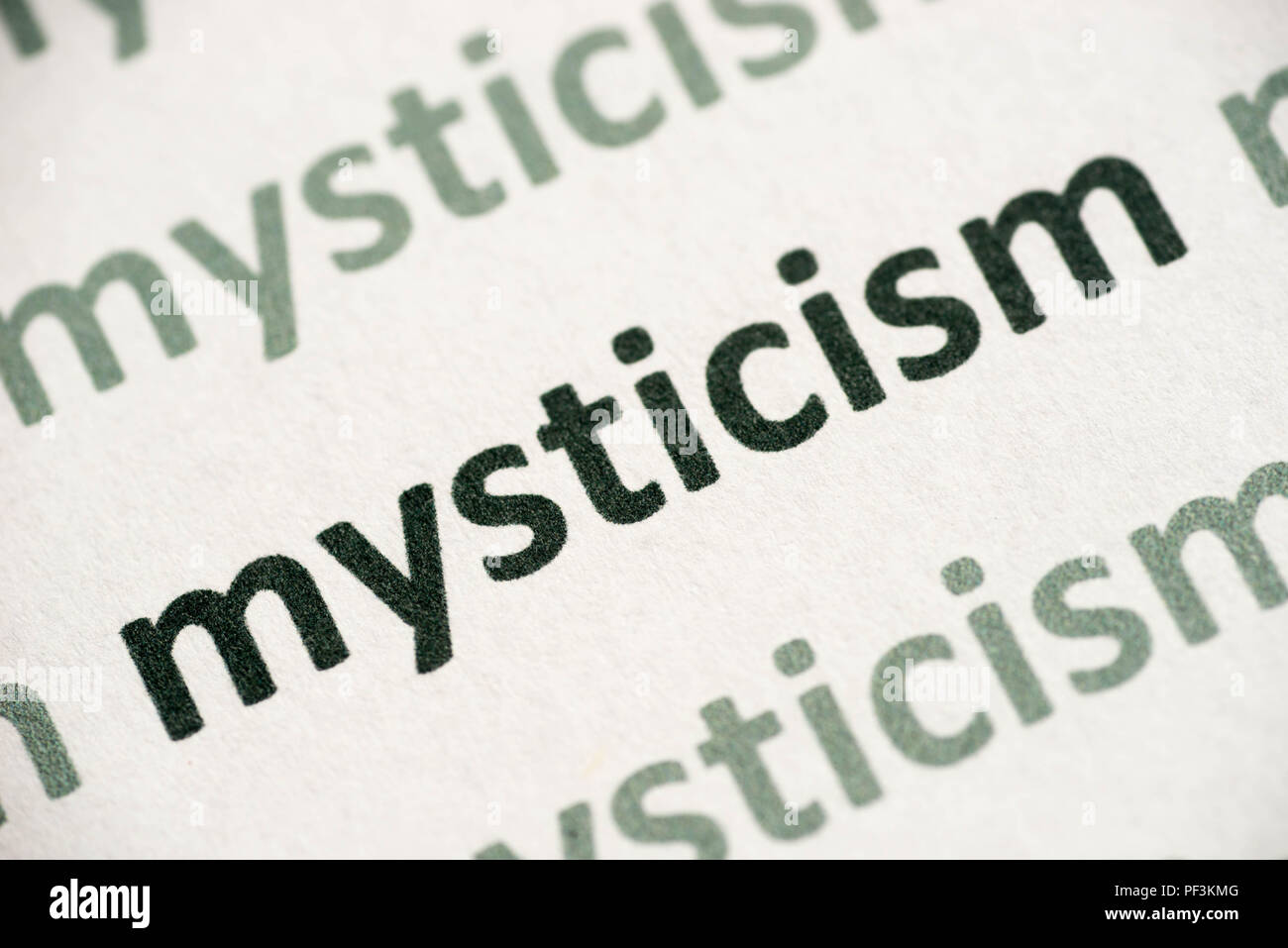 word mysticism printed on white paper macro - Stock Image