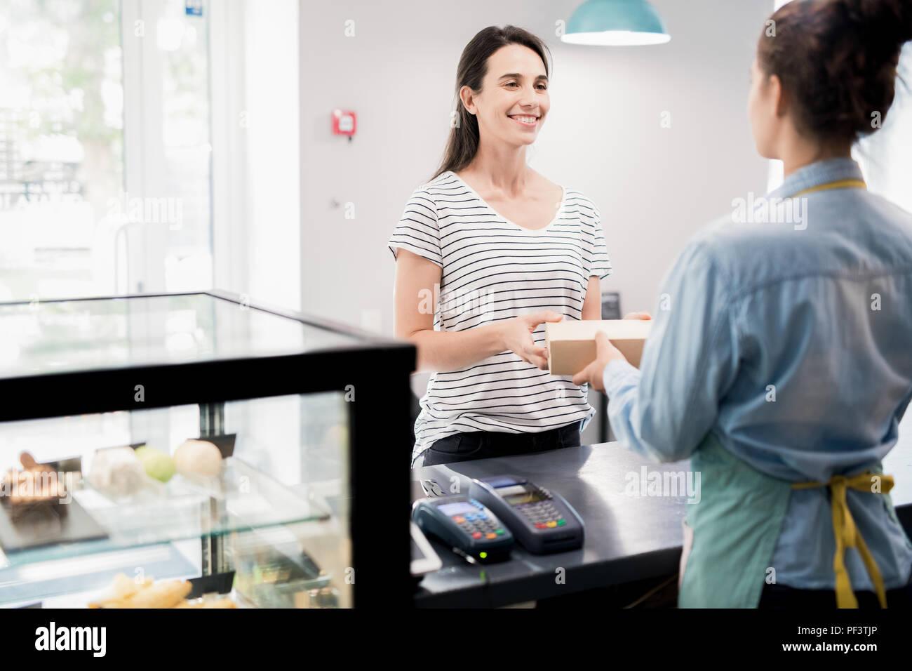 Satisfied Customer in Cake Shop - Stock Image