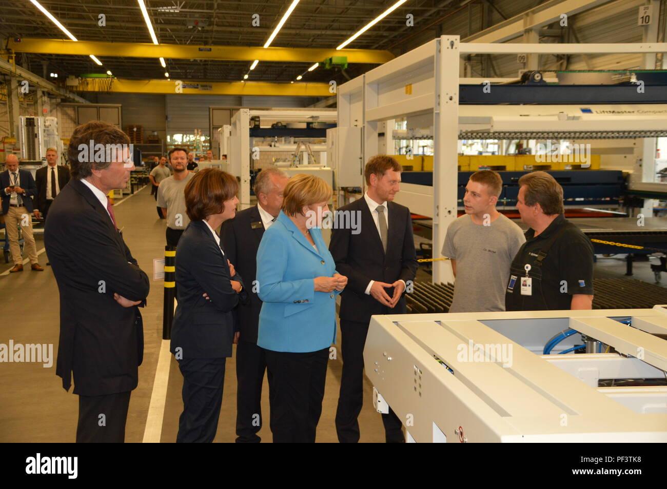 German Chancellor Angela Merkel Visits Saxony NEUKIRCH, GERMANY - AUGUST 16 2018: German Chancellor Angela Merkel and Michael Kretschmer Stock Photo