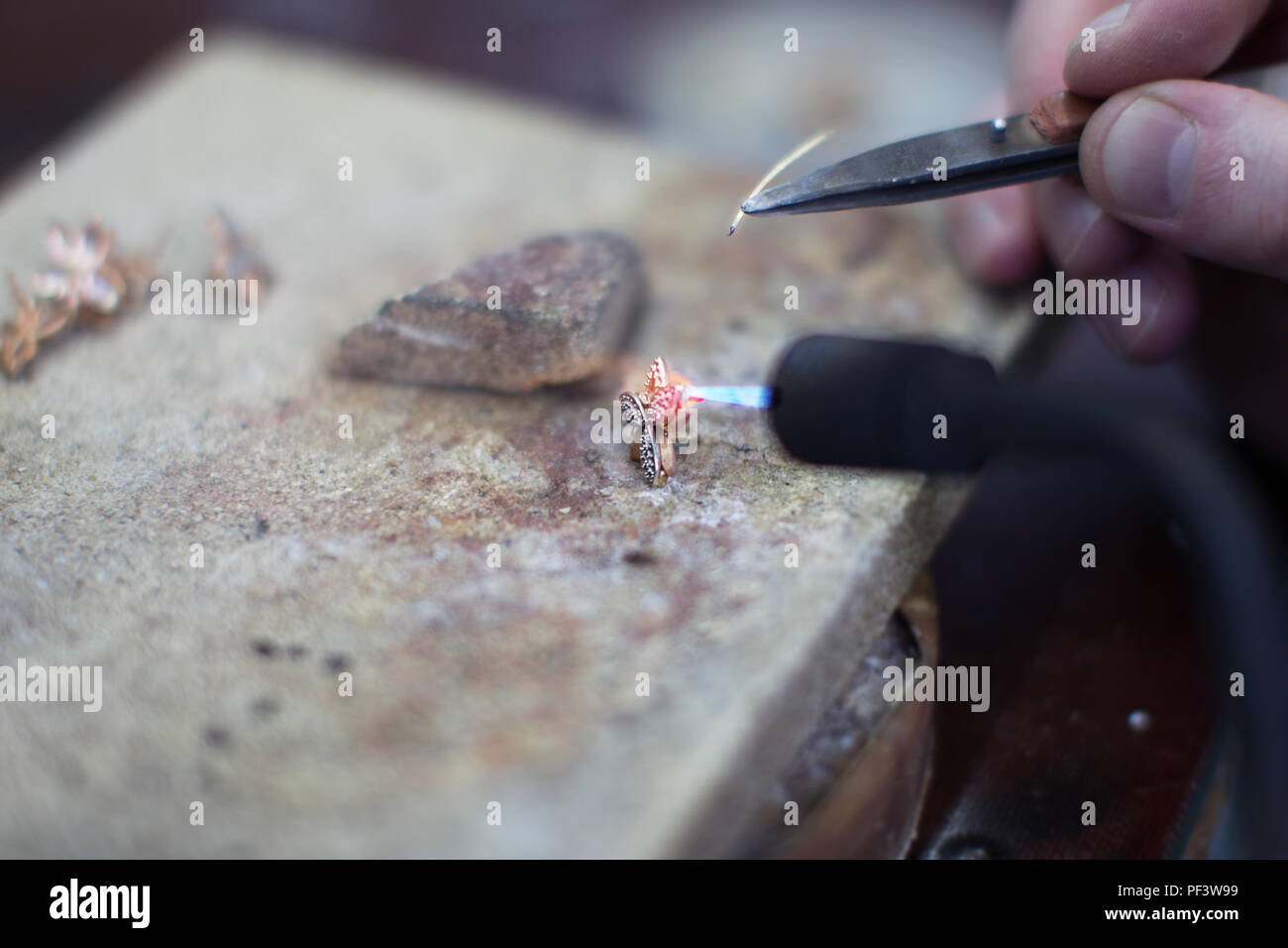 Industrial manufacture of the gold ring.Making a Gold Product - Stock Image