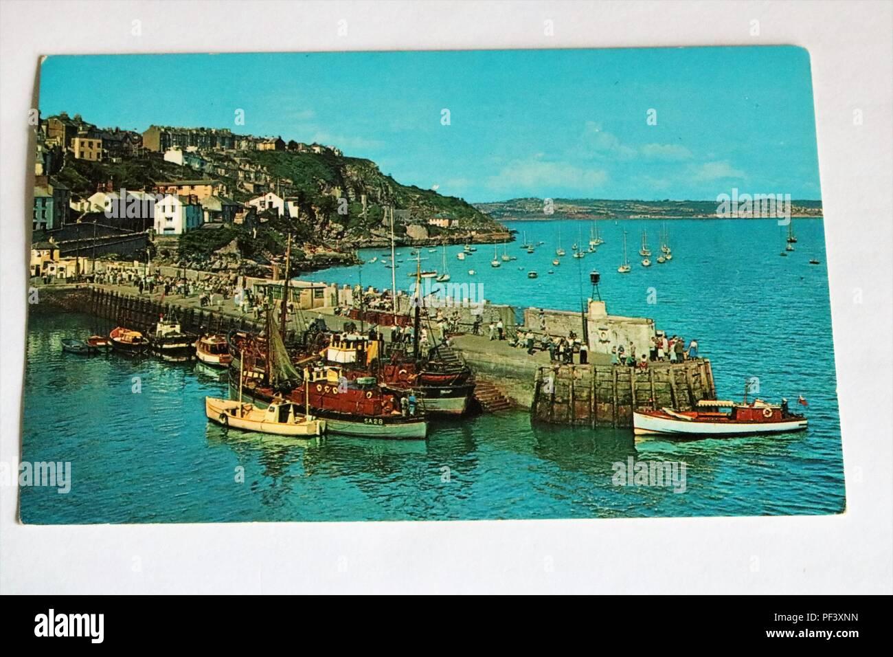 1960s 1970s colour photo postcard of The Pier, Brixham, Devon, UK - Social History - Stock Image