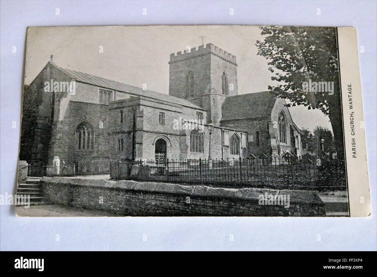Old black and white postcard of the Parish Church, Wantage, UK - Stock Image