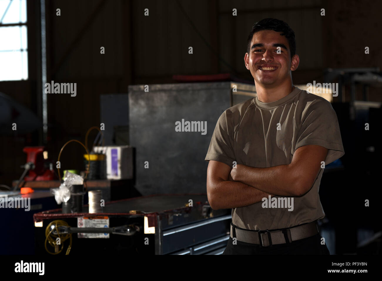 U.S. Air Force Airman 1st Class Jimmy Knutson, 20th Equipment Maintenance Squadron tactical aircraft maintainer, stands next to toolboxes in his work center at Shaw Air Force Base, S.C., Aug. 10, 2018. Knutson and other Airmen from across the base received the opportunity to share their ideas of what it means to serve in the Air Force. (U.S. Air Force photo by Senior Airman Kathryn R.C. Reaves) Stock Photo