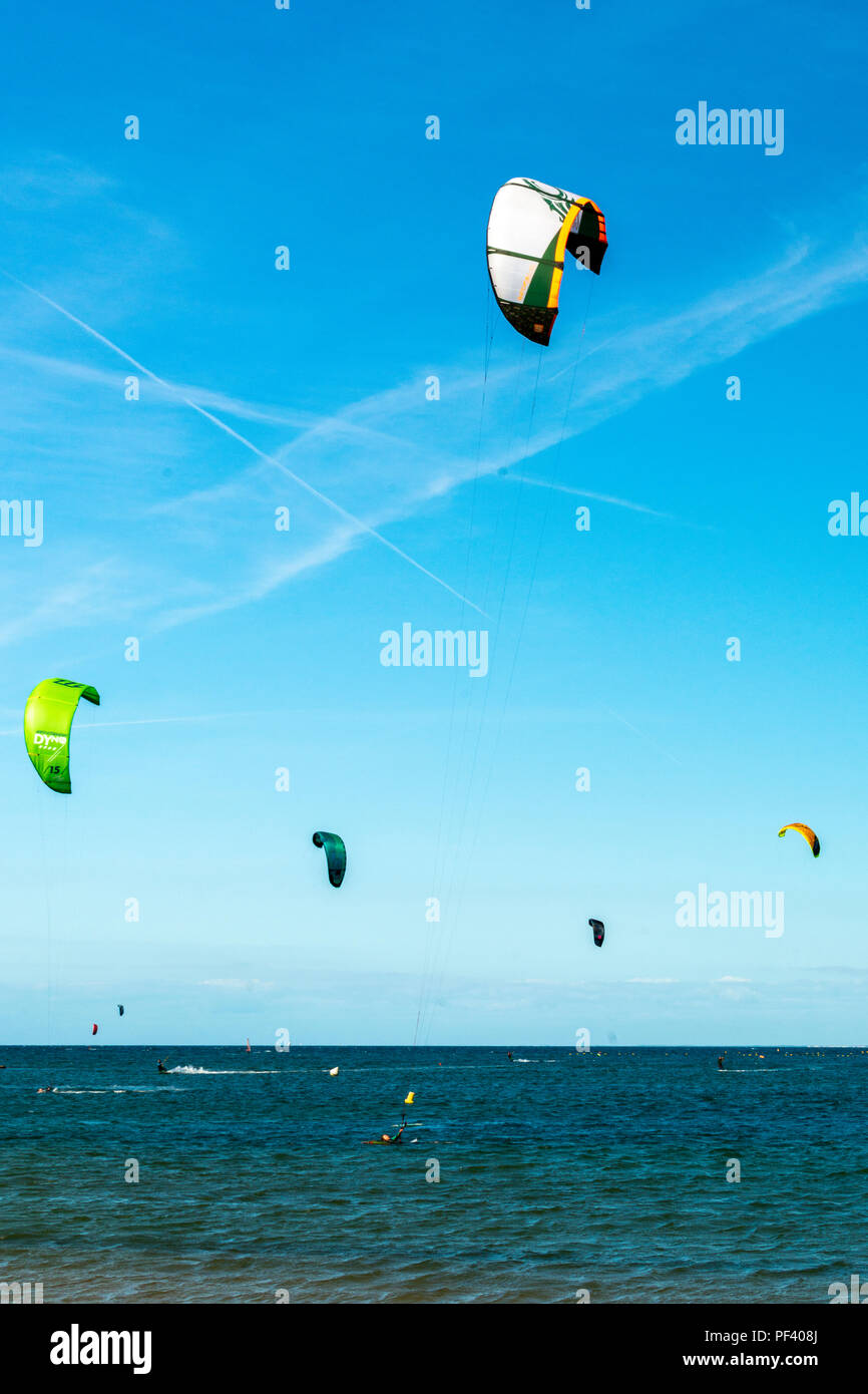 Powerkites in the atlantic sea, Île d'Yeu, France. - Stock Image