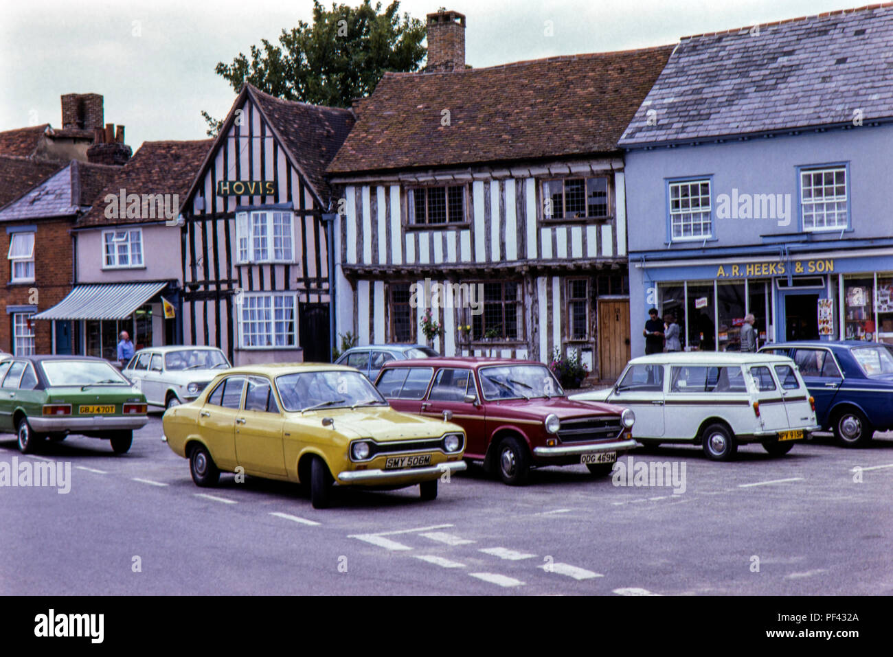 Period cars parked at Lavenham, Suffolk in August 1979 - Stock Image