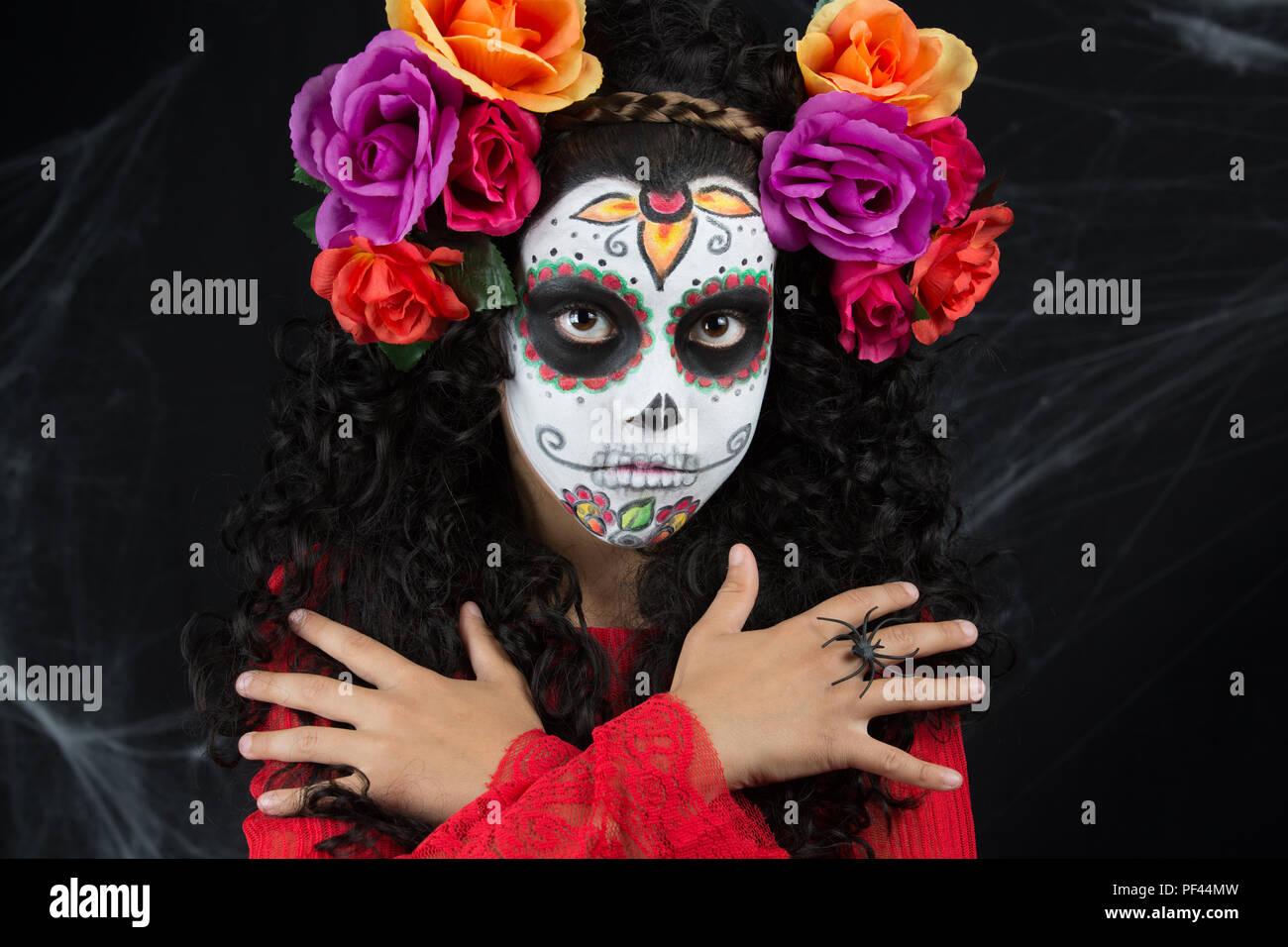 97956b86d Little girl with sugar skull makeup. Dia de los Closeup portrait of  Calavera Catrina. Little girl with sugar skull makeup. Dia de los muertos.