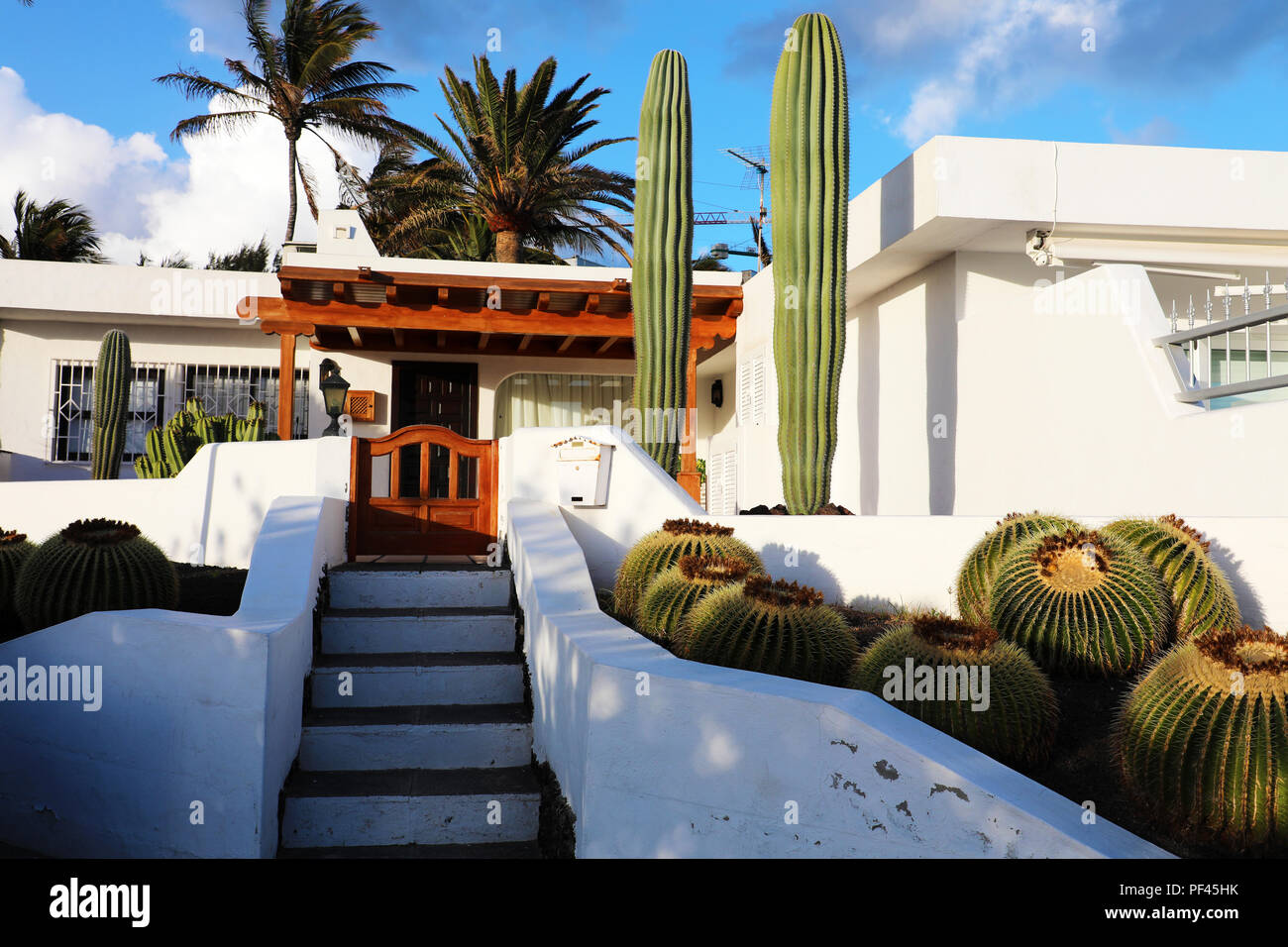 White modern house with cactus vegetation in lanzarote island spain summer vacation travel destination house rental concepts