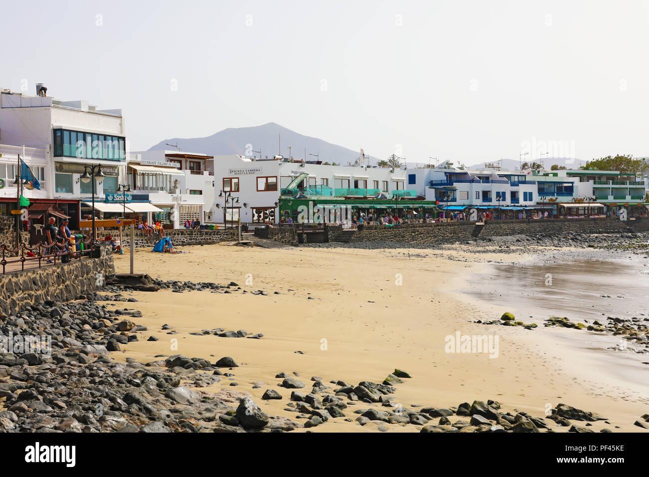 LANZAROTE, SPAIN - APRIL 18, 2018: Beautiful view of Playa Blanca beach and village, Lanzarote, Canary Islands, Spain Stock Photo