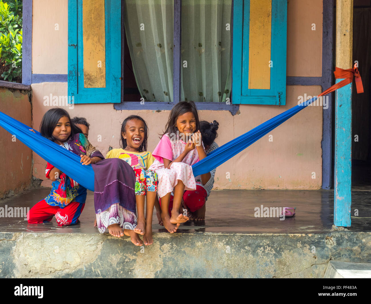 Ambon, Indonesia - February 11, 2018: A group of young Indonesian girls,