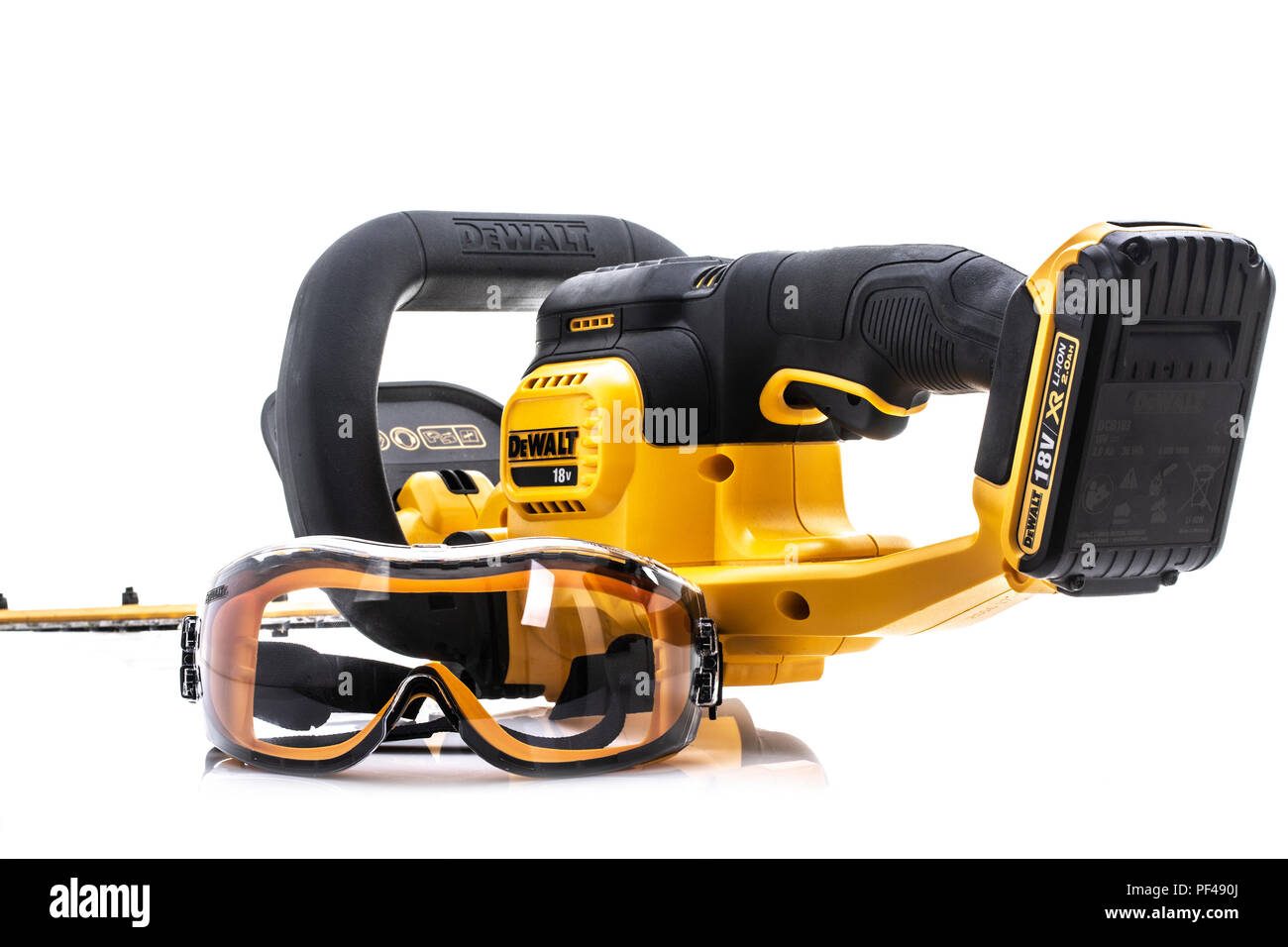 SWINDON, UK - AUGUST 19, 2018: DeWalt cordless Hedge Trimmer and safety glasses on a white background - Stock Image