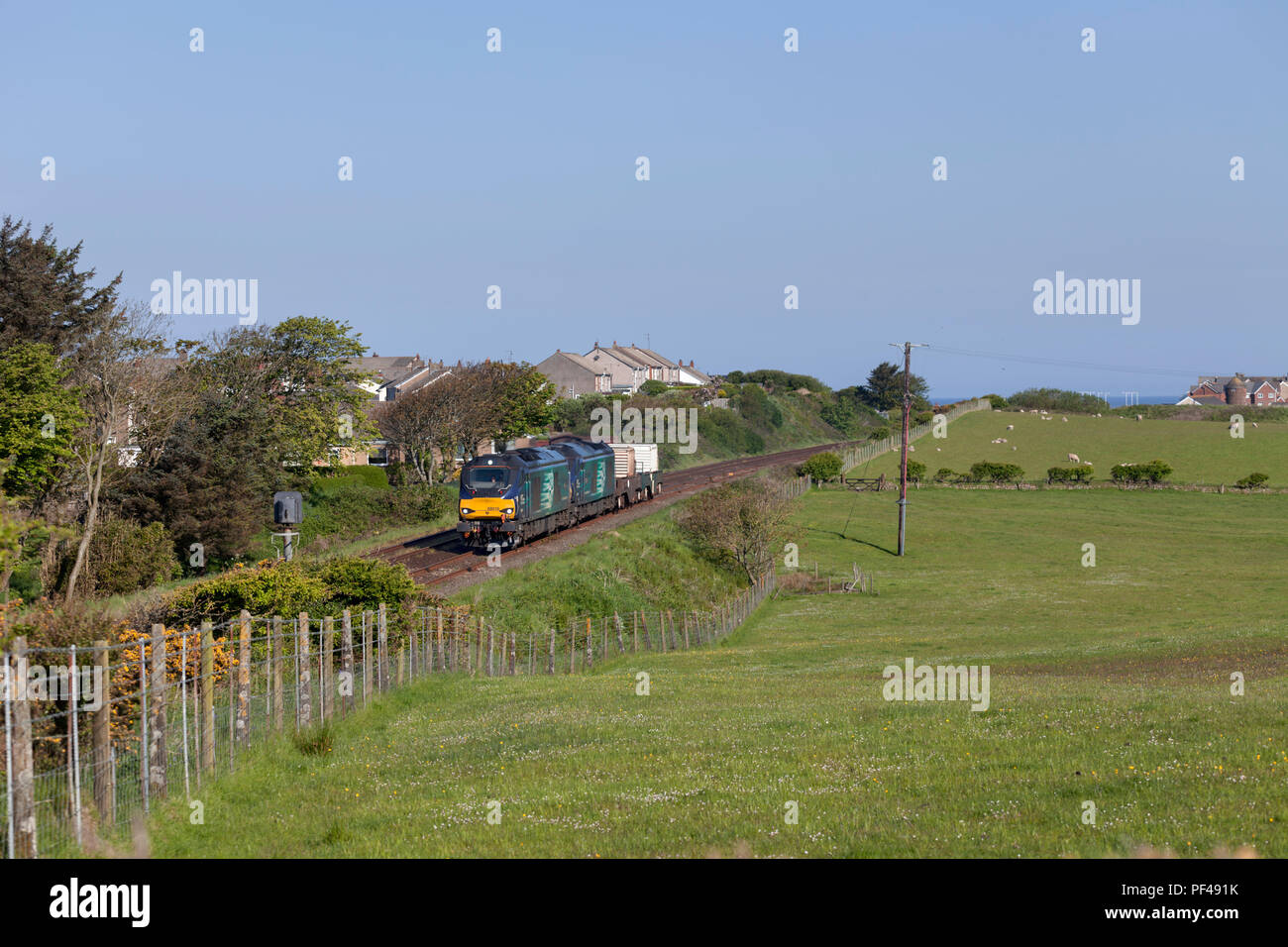 2 Direct rail Services class 68 locomotives passing Seascale (south of Sellafield) with a nuclear flask train - Stock Image
