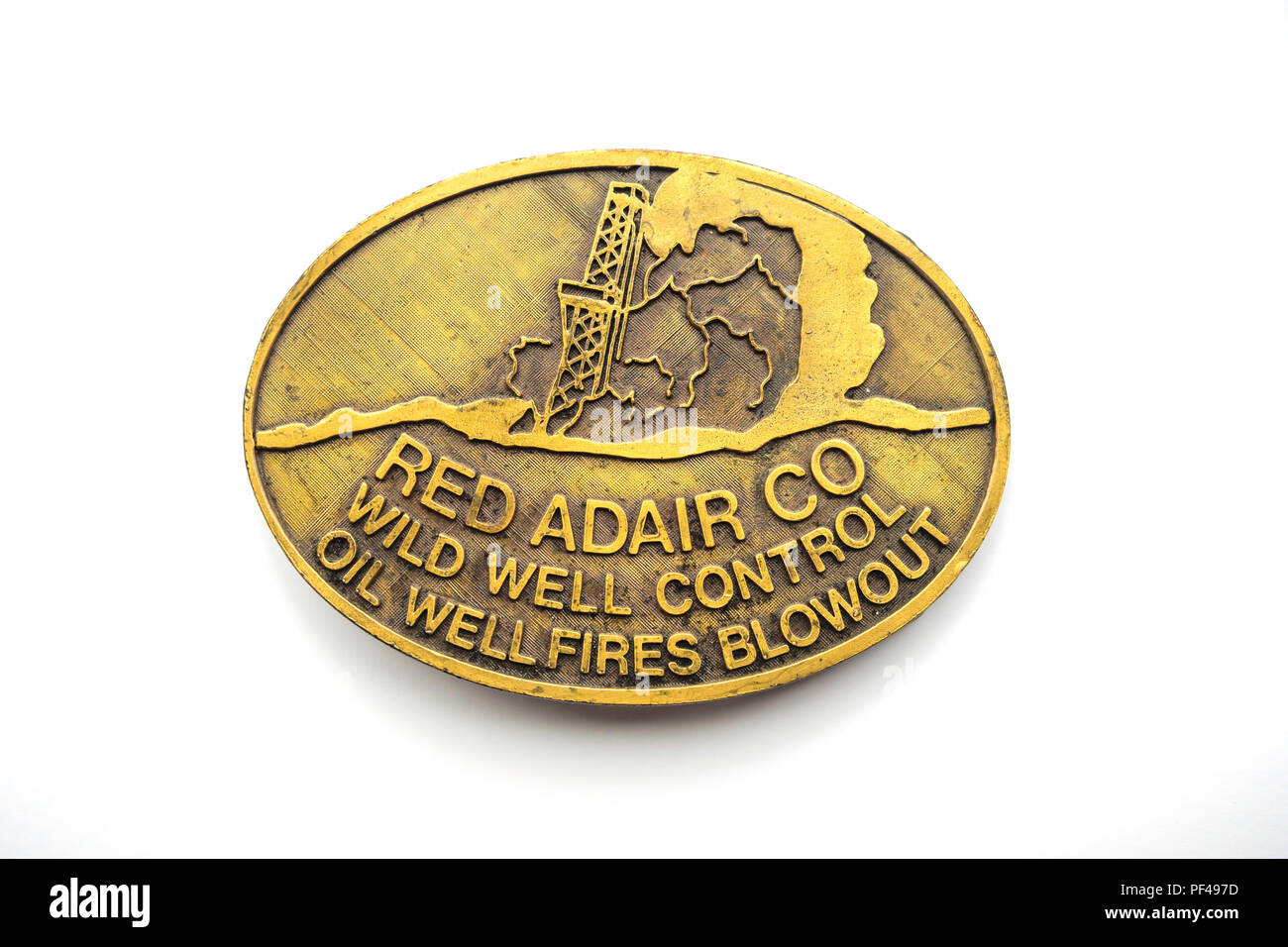 AA brass belt buckle publicity material from the Red Adair Company Wild Well Control Oil Well fires and Blowout Stock Photo