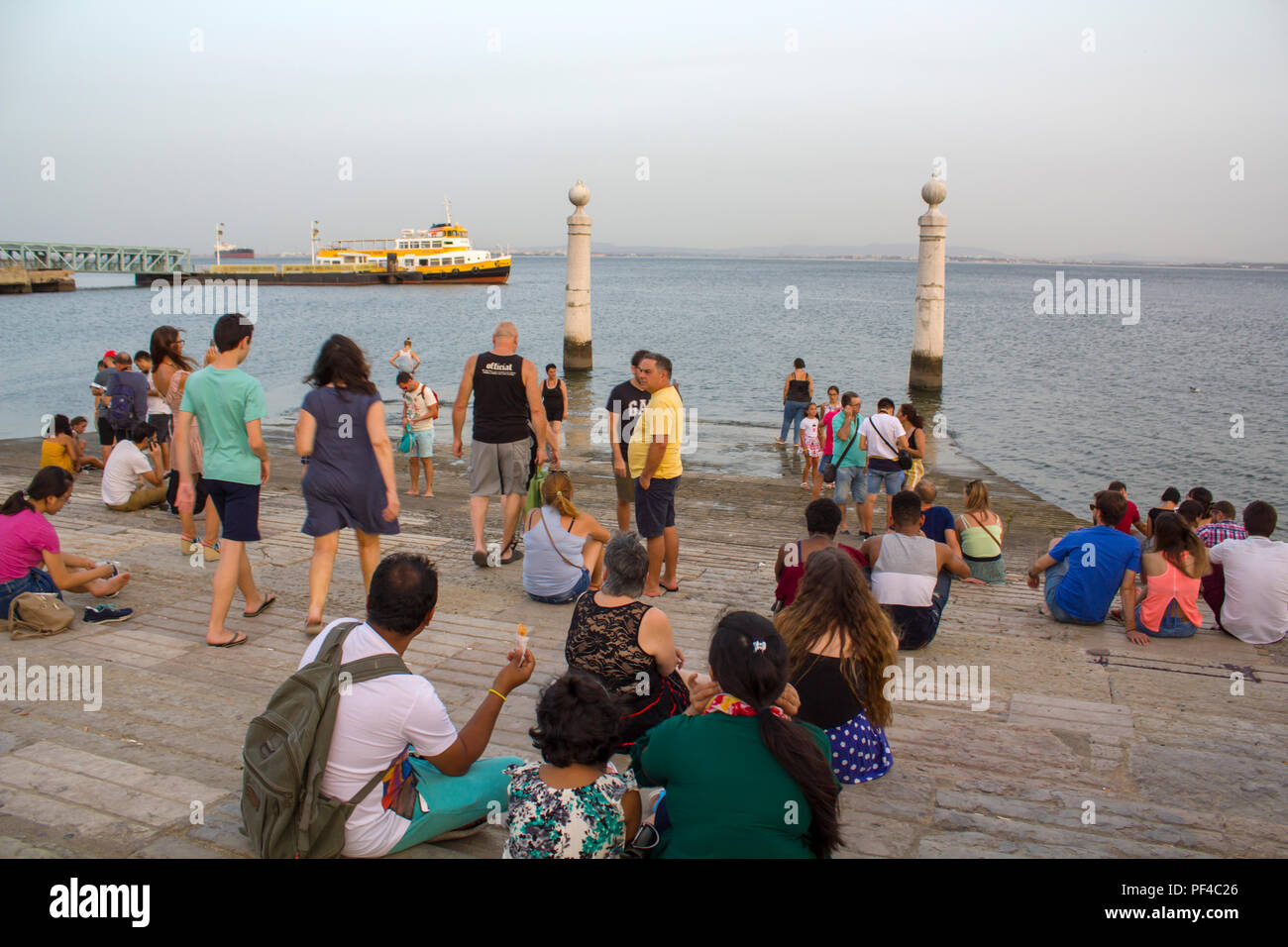 LISBON, PORTUGAL - August, CIRCA 2018: People are cooling at tagus river on one of the hottest summer days in Portugal - Stock Image