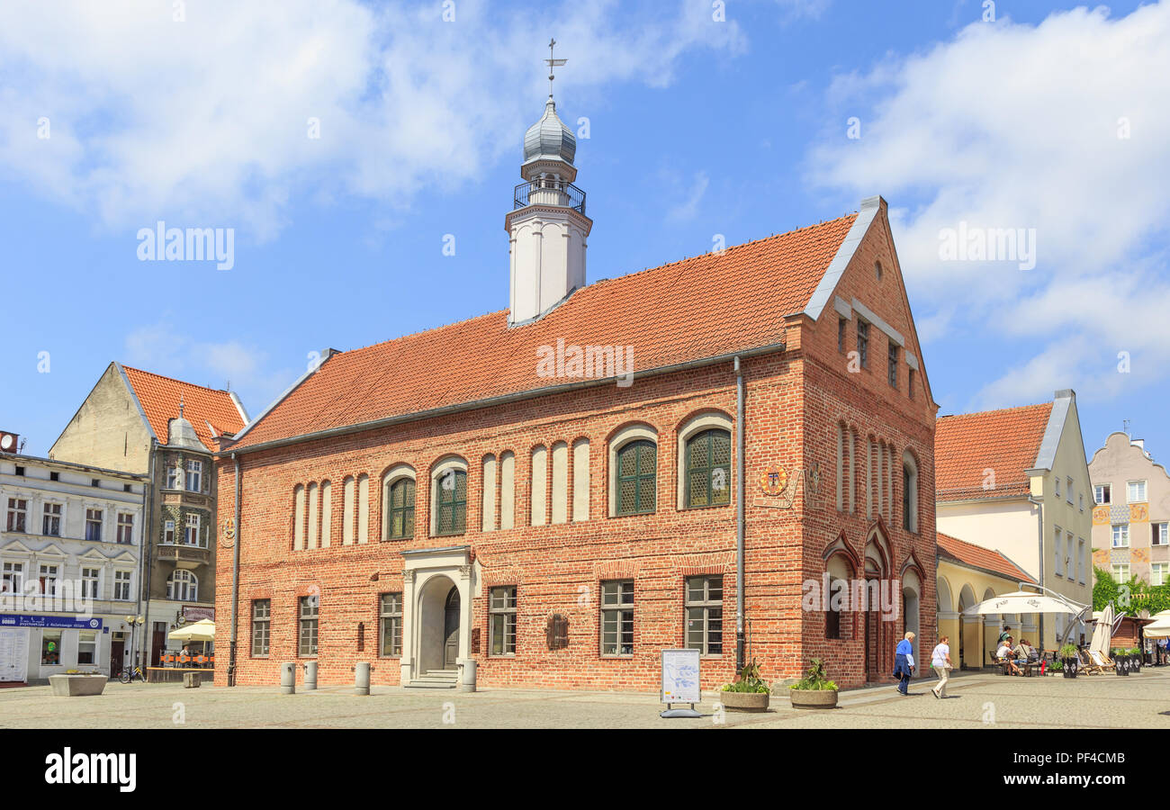 Olsztyn, Poland - Late gothic Old Town Hall on Old Town Market Square. There are sundials on walls - Stock Image