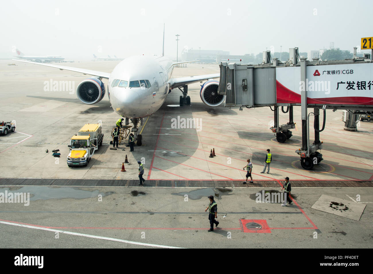 Beijing, China- June 12 2018: Airport engineer staff feeling and servicing an Aeroflot airlines airplane landed on the runway at Beijing capital Inter - Stock Image