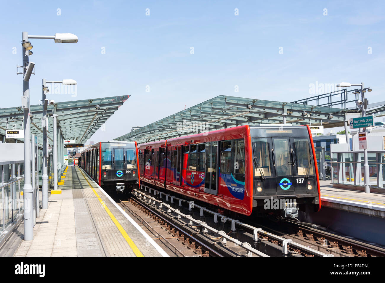 DLR Trains on platforms at West India Quay station, Canary Wharf, London Borough of Tower Hamlets, Greater London, England, United Kingdom - Stock Image
