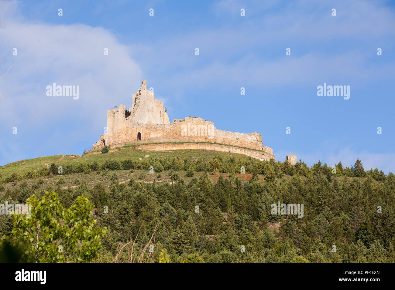 The Templar castle ruins in the Spanish town of Castrojeriz seen from the footpath the Camino de Santiago the way of St James Castille y Leon Spain - Stock Image
