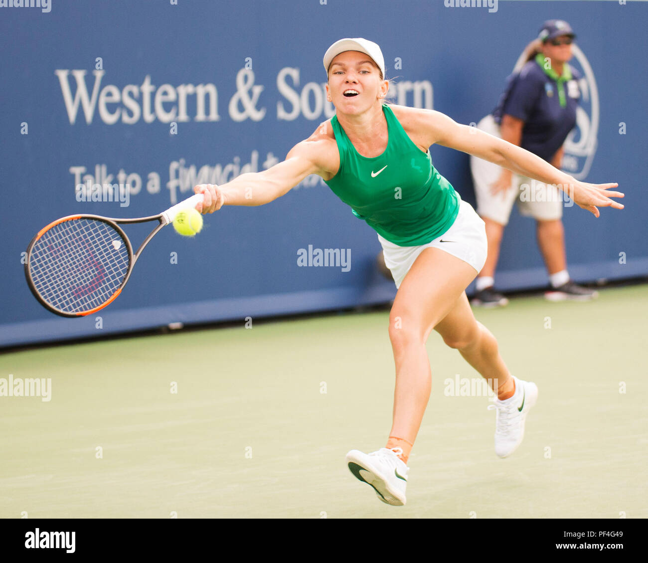 Ohio, USA. 18 August 2018.  Simona Halep (ROU) hits the ball back to Aryna Sabalenka (BLR) at the Western Southern Open in Mason, Ohio, USA. Brent Clark/Alamy Live News - Stock Image