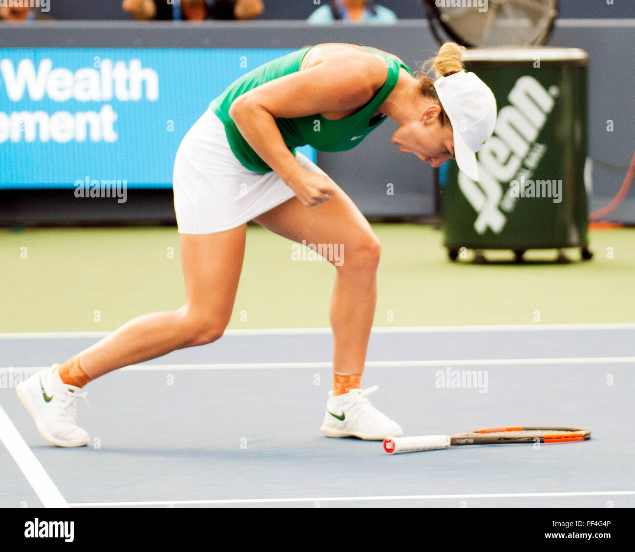 Ohio, USA. 18 August 2018.   Simona Halep (ROU) celebrates her victory against Aryna Sabalenka (BLR) at the Western Southern Open in Mason, Ohio, USA. Brent Clark/Alamy Live News - Stock Image
