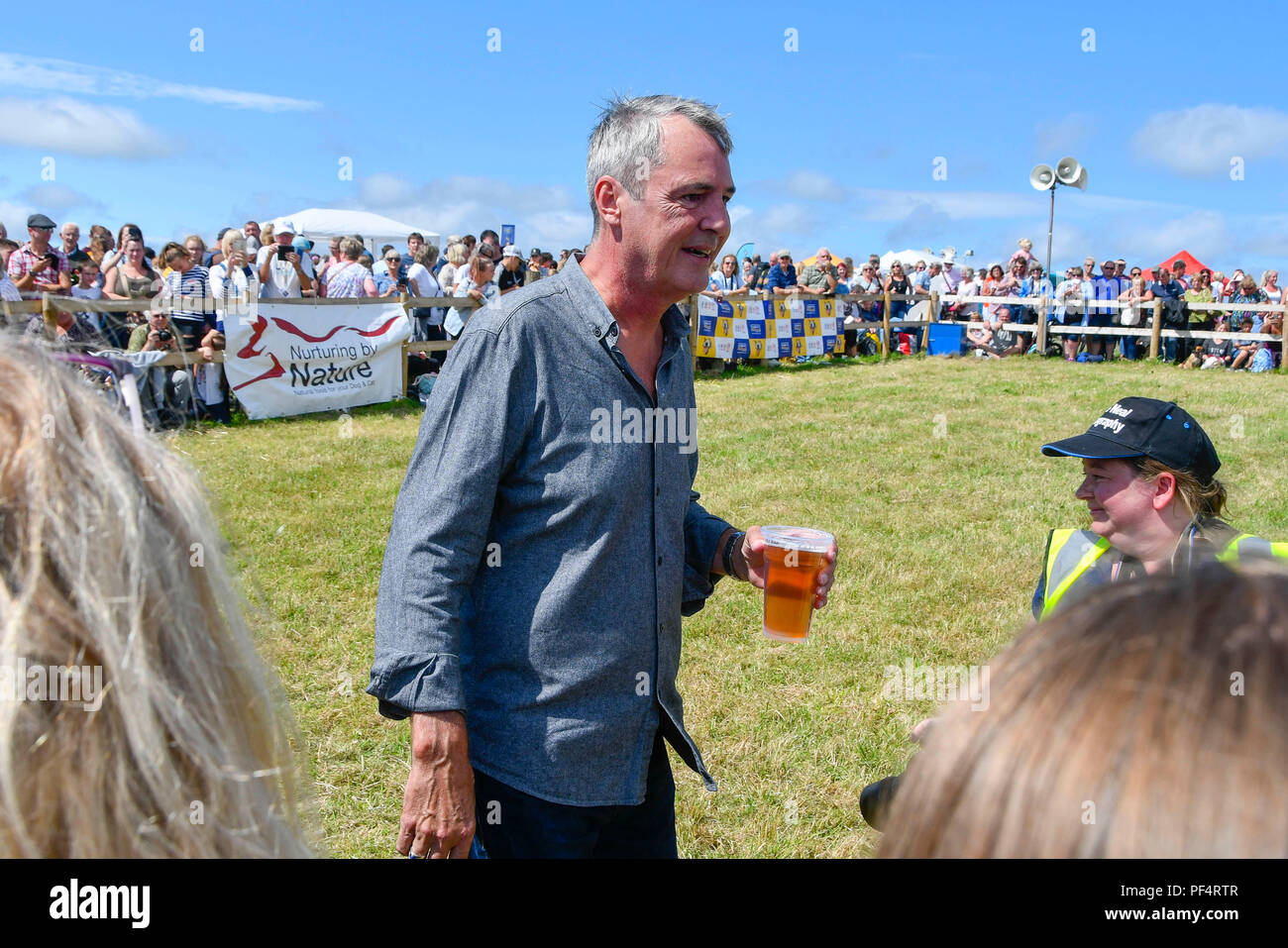 Beaminster, Dorset, UK.  19th August 2018. UK Weather.  Actor Neil Morrissey who has a pint of lager at Buckham Fair at Beaminster, Dorset.  Picture Credit: Graham Hunt/Alamy Live News - Stock Image
