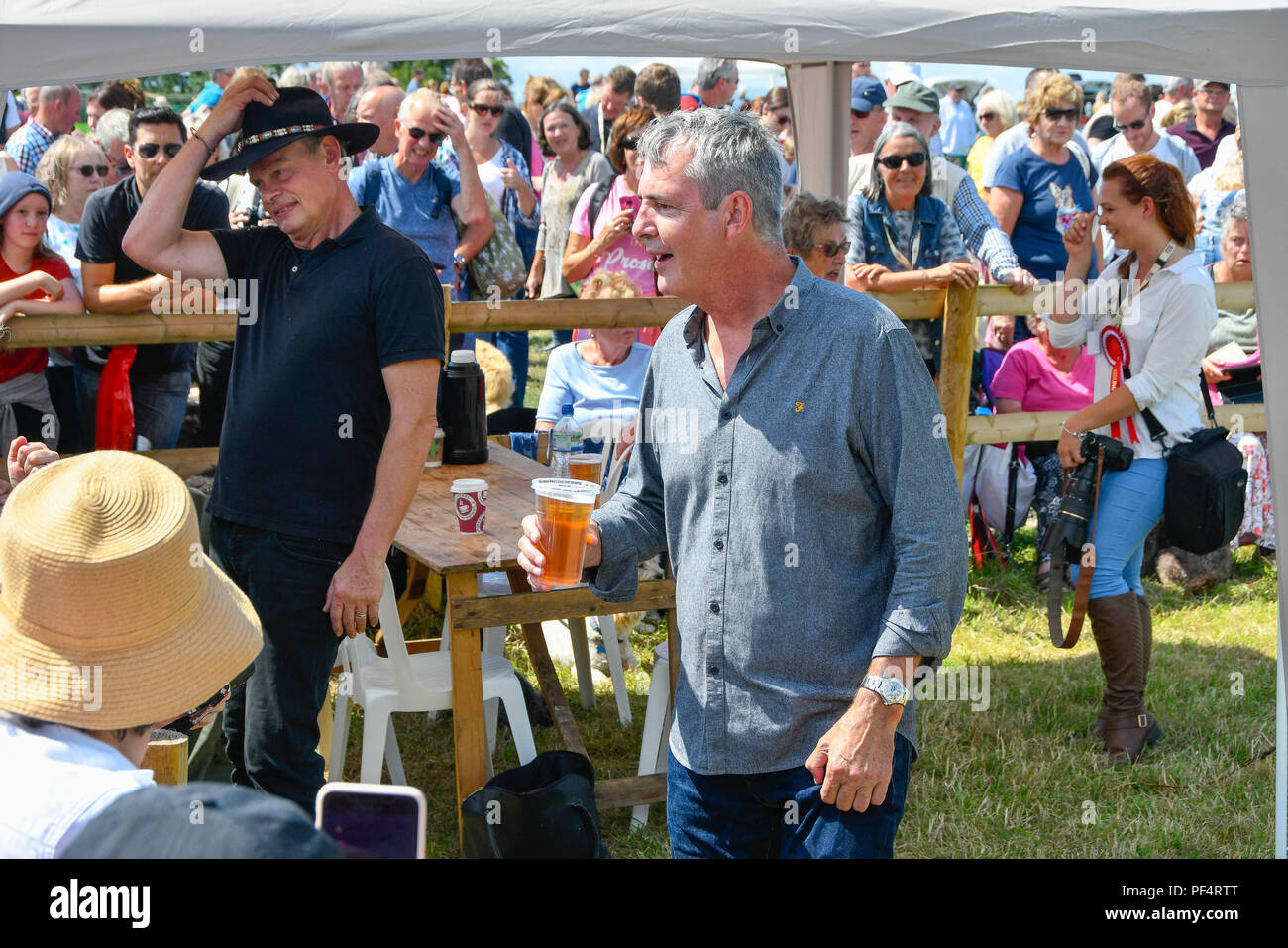 Beaminster, Dorset, UK.  19th August 2018. UK Weather.  Actor Martin Clunes with Actor Neil Morrissey who has a pint of lager at Buckham Fair at Beaminster, Dorset.  Picture Credit: Graham Hunt/Alamy Live News - Stock Image