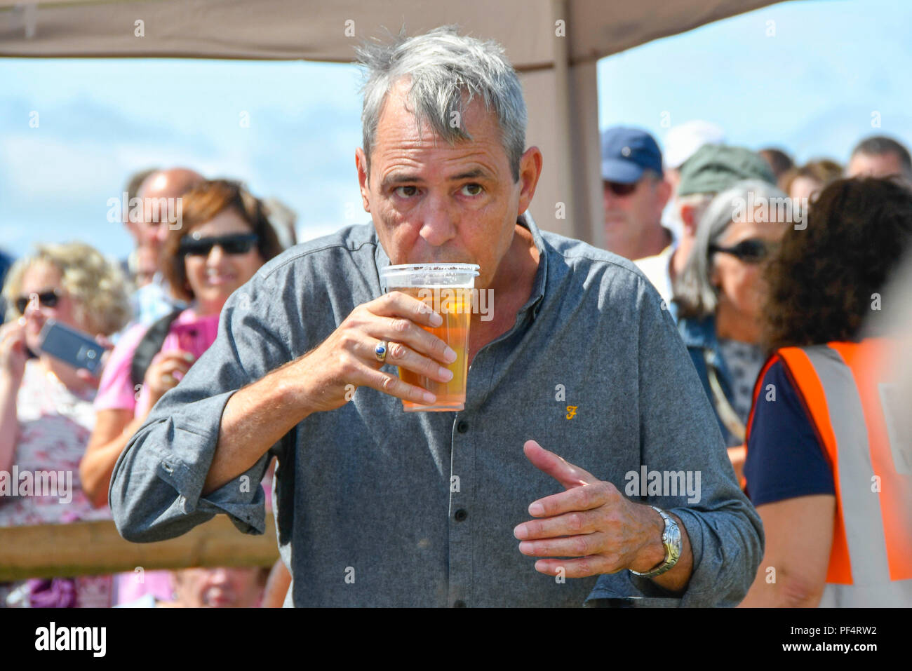 Beaminster, Dorset, UK.  19th August 2018. UK Weather.  Actor Neil Morrissey with a pint of lager at Buckham Fair at Beaminster, Dorset.  Picture Credit: Graham Hunt/Alamy Live News - Stock Image