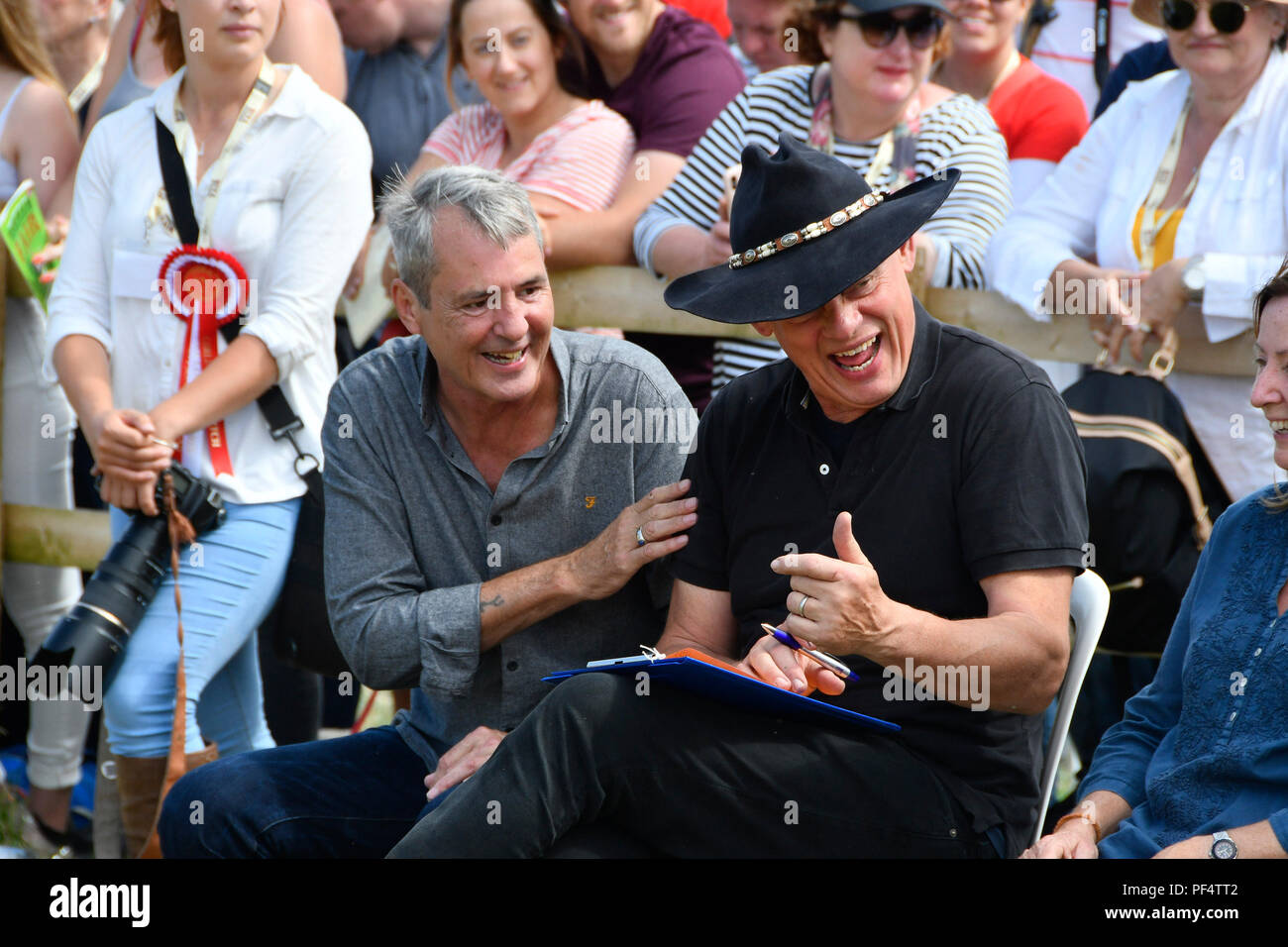 Beaminster, Dorset, UK.  19th August 2018. UK Weather.  Actor Martin Clunes is joined by his friend and fellow actor Neil Morrissey to judge the best dog trick at Buckham Fair at Beaminster, Dorset.  Picture Credit: Graham Hunt/Alamy Live News - Stock Image