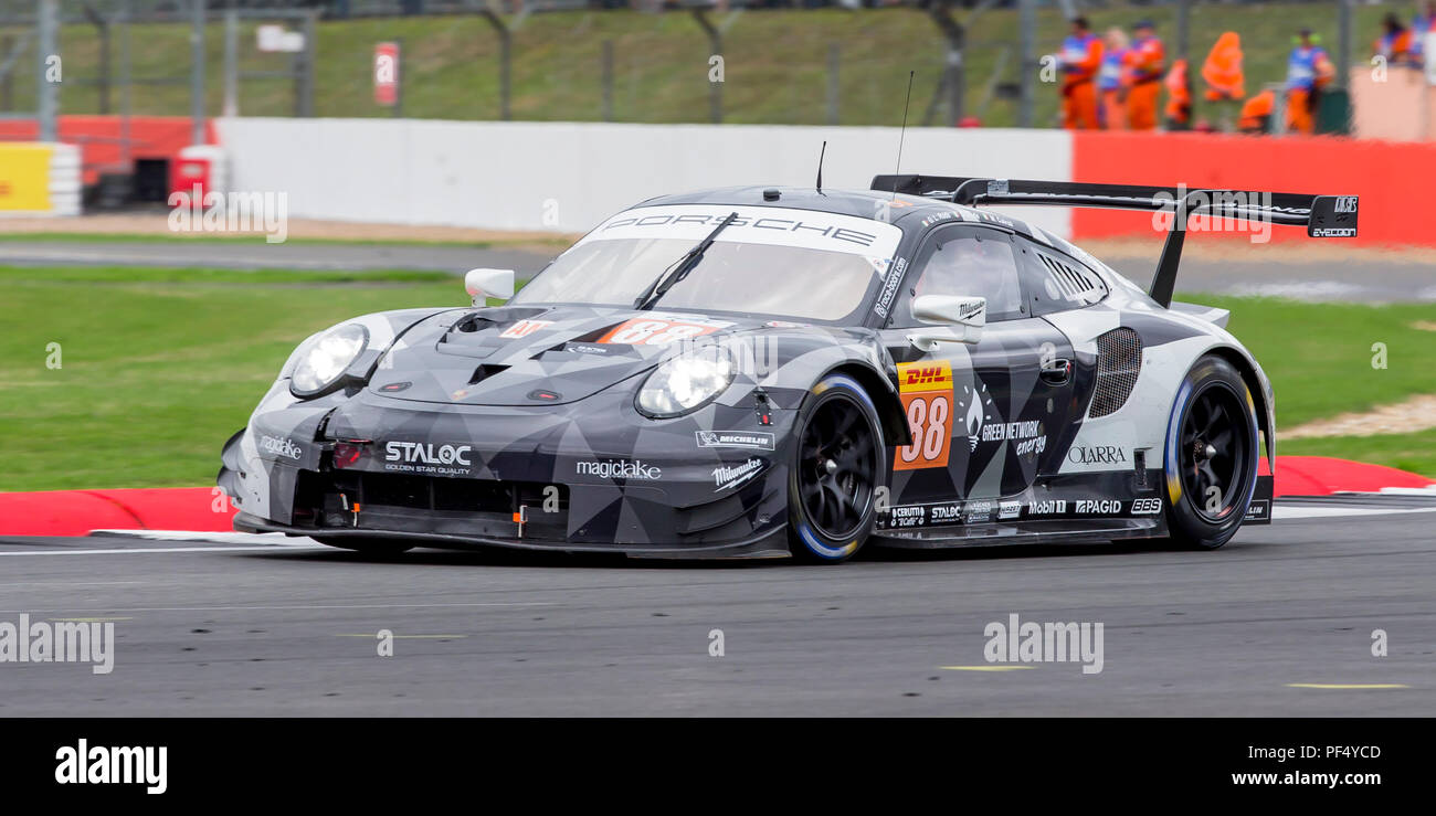 Silverstone Circuit, UK. 19th Aug, 2018. FIA World Endurance Championship; The Aston Martin Vantage LMGTE Am racing car from Aston Martin Racing Team (GBR) driven by Paul Dalla Lana (CAN) Pedro Lamy (PRT) and Mathias Lauda (AUT) with front wing damage as it enters the home straight during Round 3 of the FIA World Endurance Championship at Silverstone Credit: Action Plus Sports/Alamy Live News Stock Photo