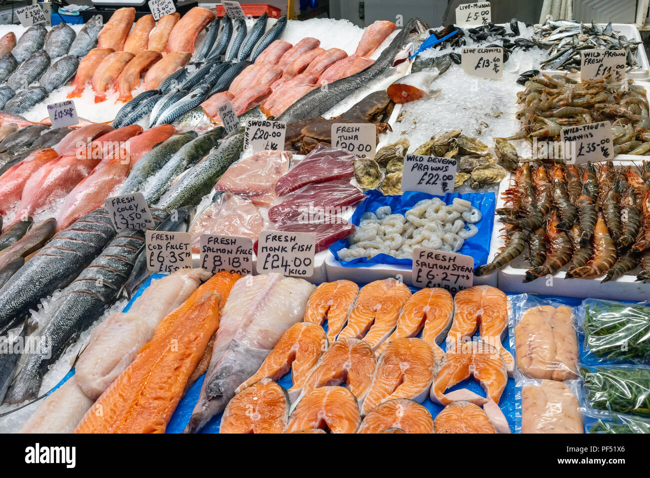Fresh fish and crustaceans for sale at a market in Brixton, London - Stock Image