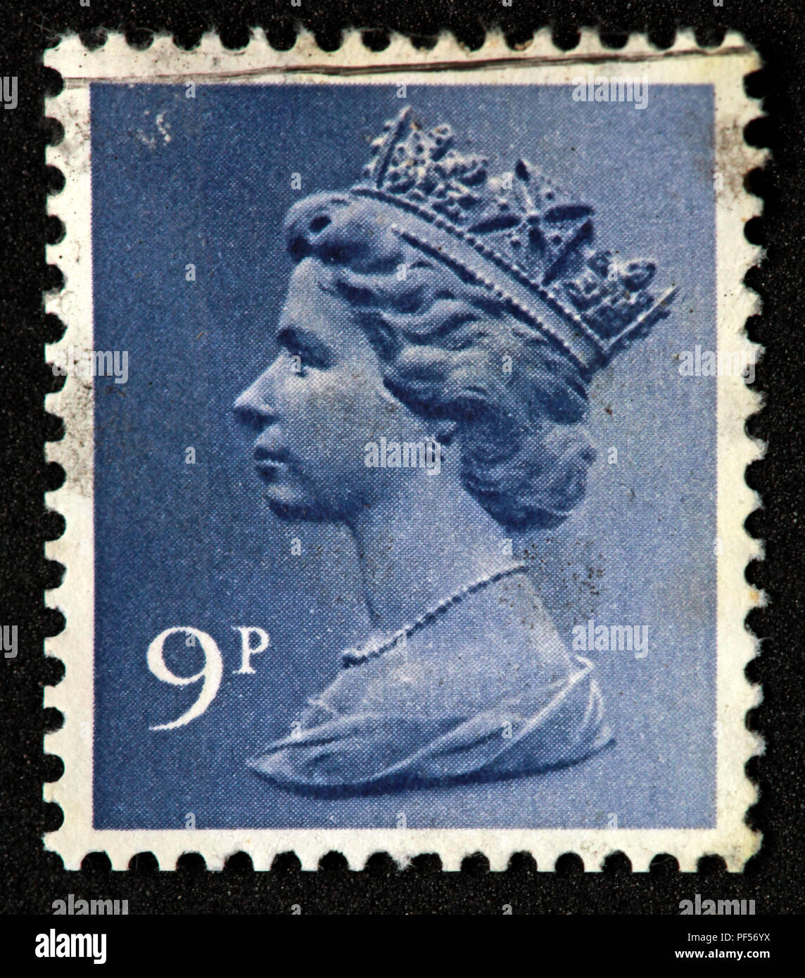 Used franked blue British UK stamp - 9p - Queen Elizabeth II - Stock Image