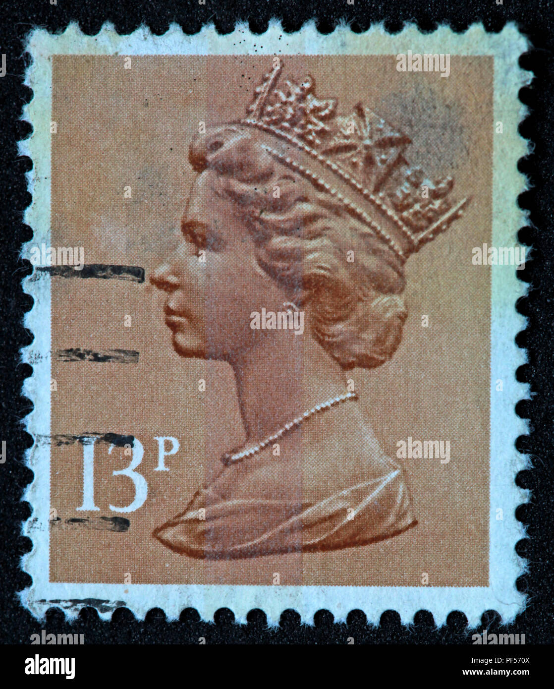 Used franked brown British UK stamp - 13p - Queen Elizabeth II - Stock Image