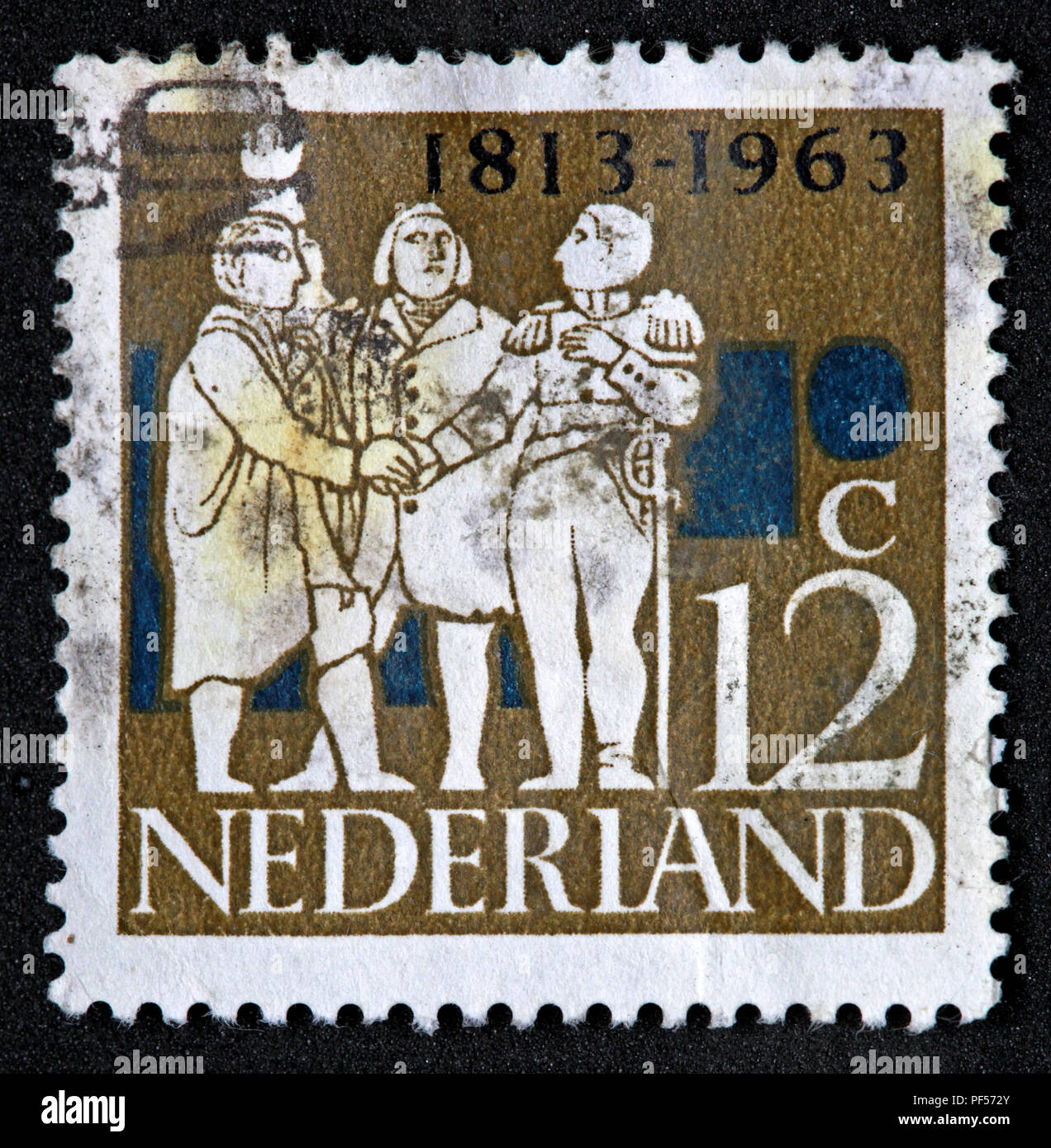 Used franked Nederland Netherlands Stamp, Brown 12c Twelve Cent 1813-1963 - Stock Image
