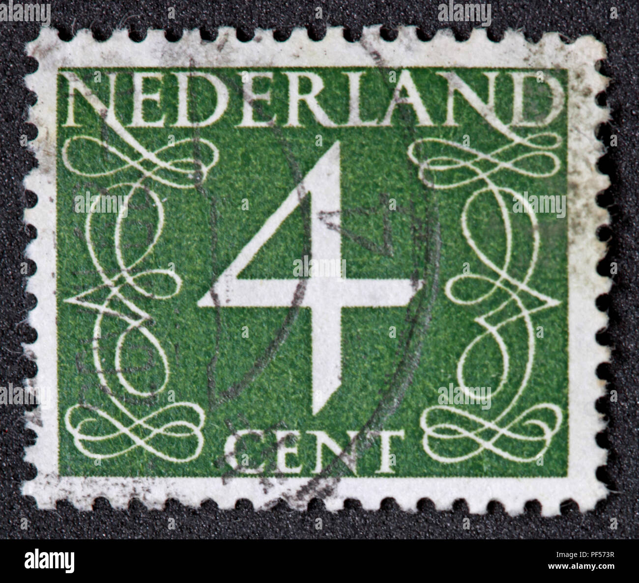 Used franked Nederland Netherlands Stamp, Green 4c Four Cent - Stock Image