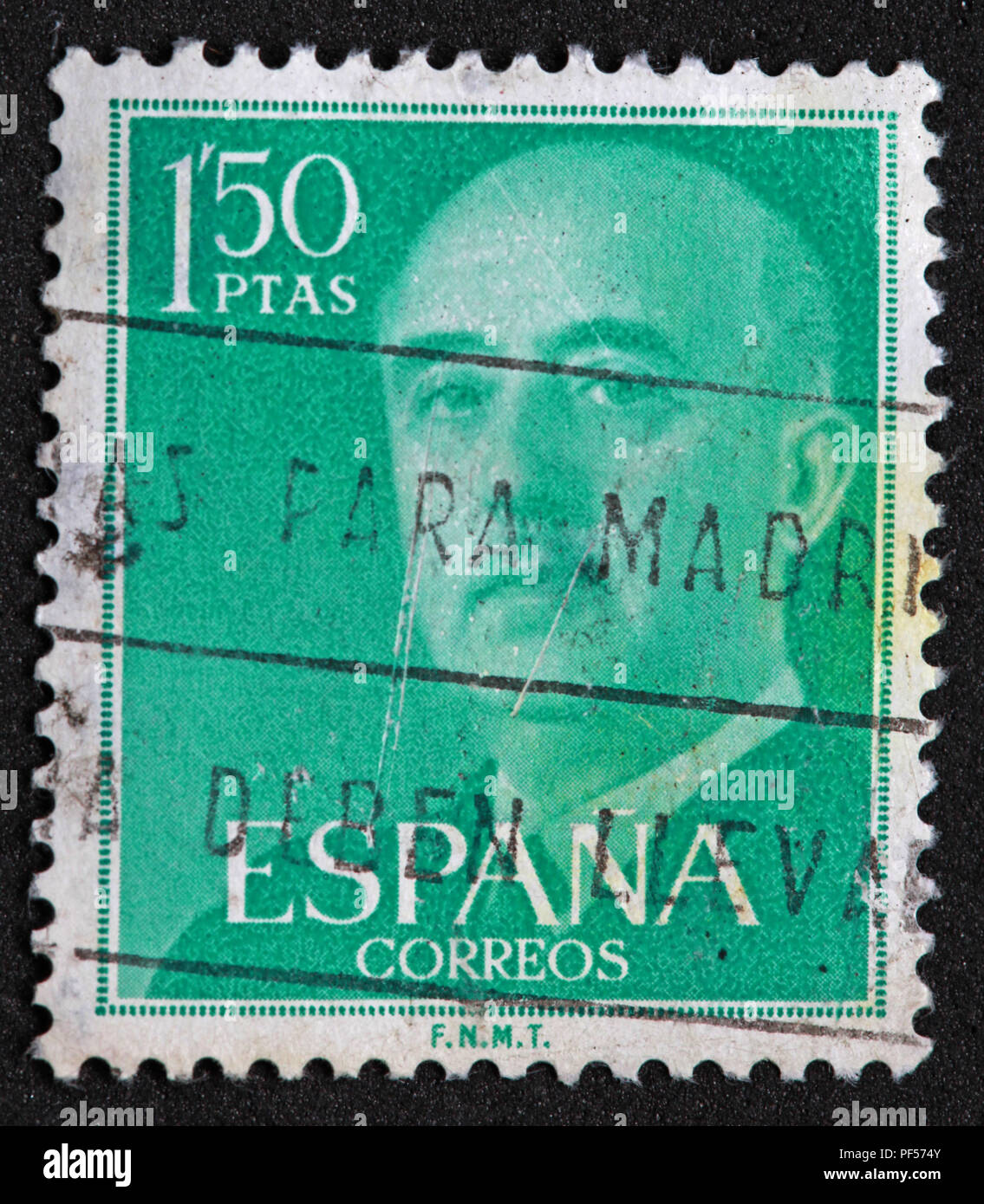 Used 1.5ptas Peseta green stamp - Stock Image