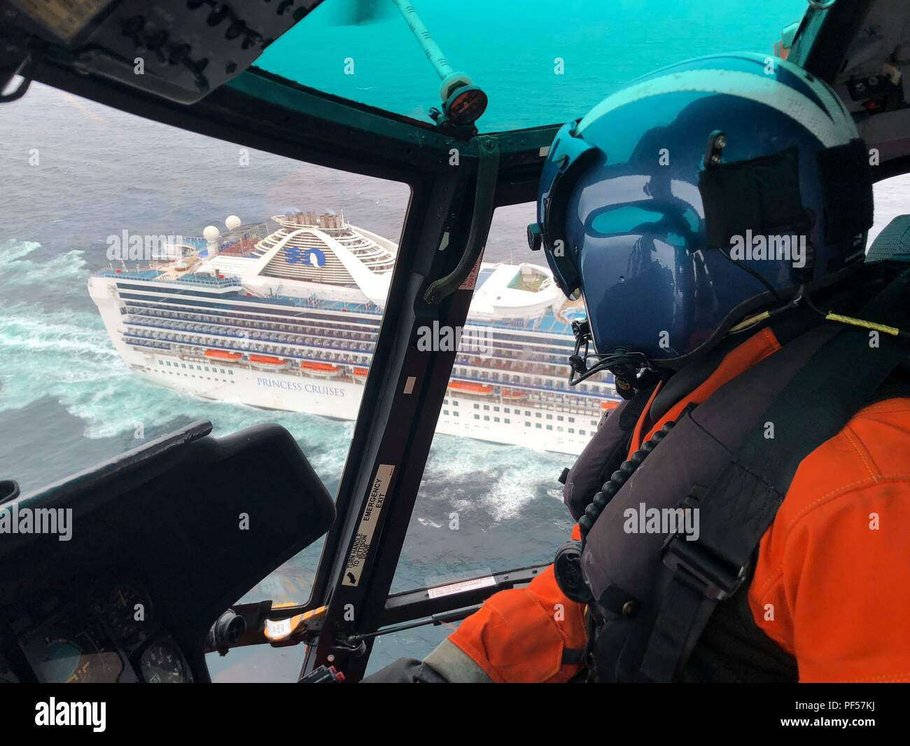 A Coast Guard Sector North Bend aircrew medically evacuated a woman reportedly suffering from kidney failure while aboard a cruise ship 50 miles southwest of Coos Bay, Aug. 13, 2018. The aircrew arrived on scene aboard an MH-65 Dolphin helicopter crew, medevac'd the woman from the ship named Grand Princess and safely transported her to the Bay Area Hospital at 12:50 p.m. U.S. Coast Guard video. - Stock Image