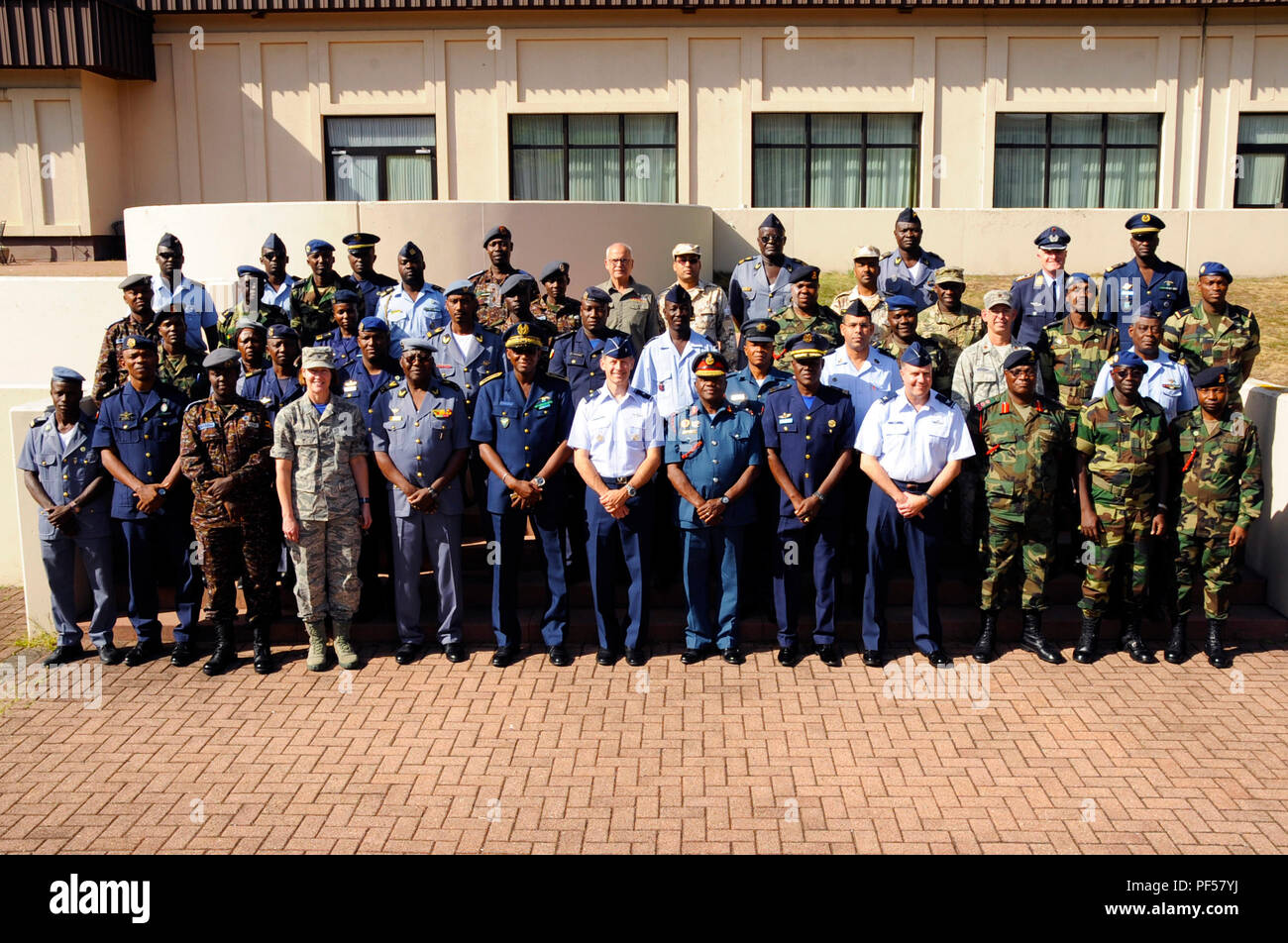 Participants from seven different African partner nations and U.S. Service Members, pose for a photo during African Partnership Flight, hosted by U.S. Air Forces Africa and co-hosted by Mauritania and Senegal at Ramstein Air Base, Germany, Aug. 9, 2018. The APF program is Air Forces in Africa's premier security cooperation program with African partner nations to improve professional military aviation knowledge and skills. (U.S. Army photo by Spc. Craig Jensen) - Stock Image