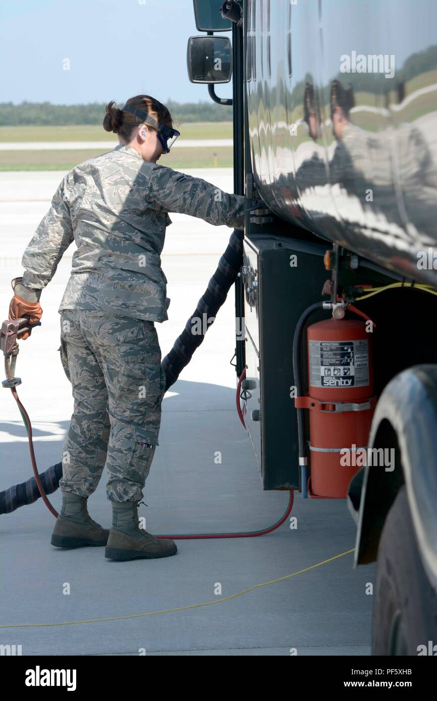Airman 1st Class Emily Brinkman of the 180th Fighter Wing, Toldeo, Ohio performs a fast refuel for a Black Hawk UH-60 helicopter during Northern Strike 18, Alpena, Mich., August 9, 2018.    Northern Strike 18 is a National Guard Bureau-sponsored exercise uniting service members from many states, multiple service branches and a number of coalition countries during the first three weeks of August 2018 at the Camp Grayling Joint Maneuver Training Center and the Alpena Combat Readiness Training Center, both located in northern Michigan and operated by the Michigan National Guard. The accredited Jo - Stock Image