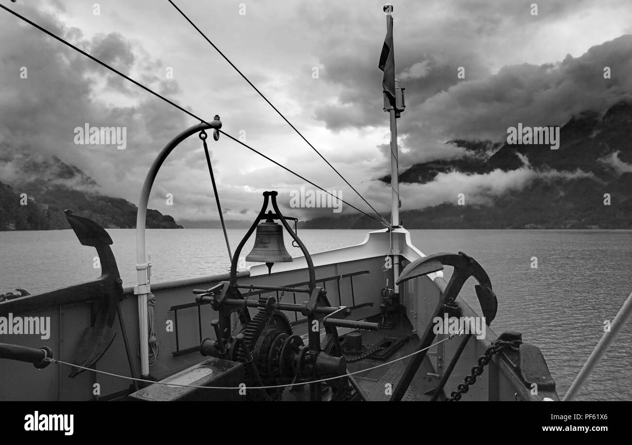 PS Lötschberg (built in 1914 by Escher-Wyss, Zurich) under way on the Brienzersee, Bernese Oberland, Switzerland on a cloudy day. Black & white - Stock Image
