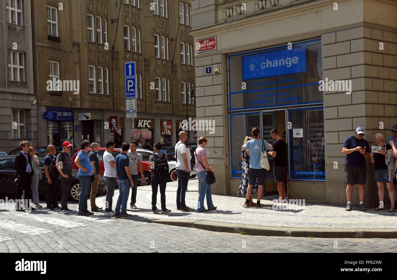 Tourists queueing for currency money exchange in Prague Czech Republic Stock Photo