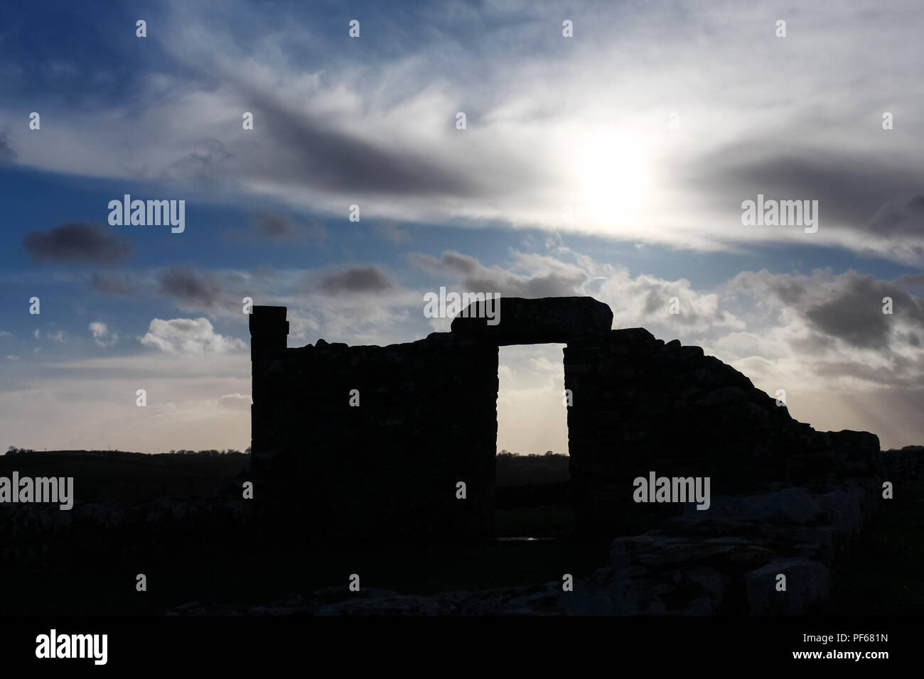 Skyscape with silhouette of old ruins of Nendrum Monastry, Mahee Island, County Down, N.Ireland. - Stock Image