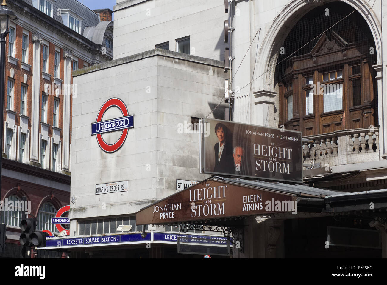 Leicester square underground and the advertising of The Height of the storm, London - Stock Image