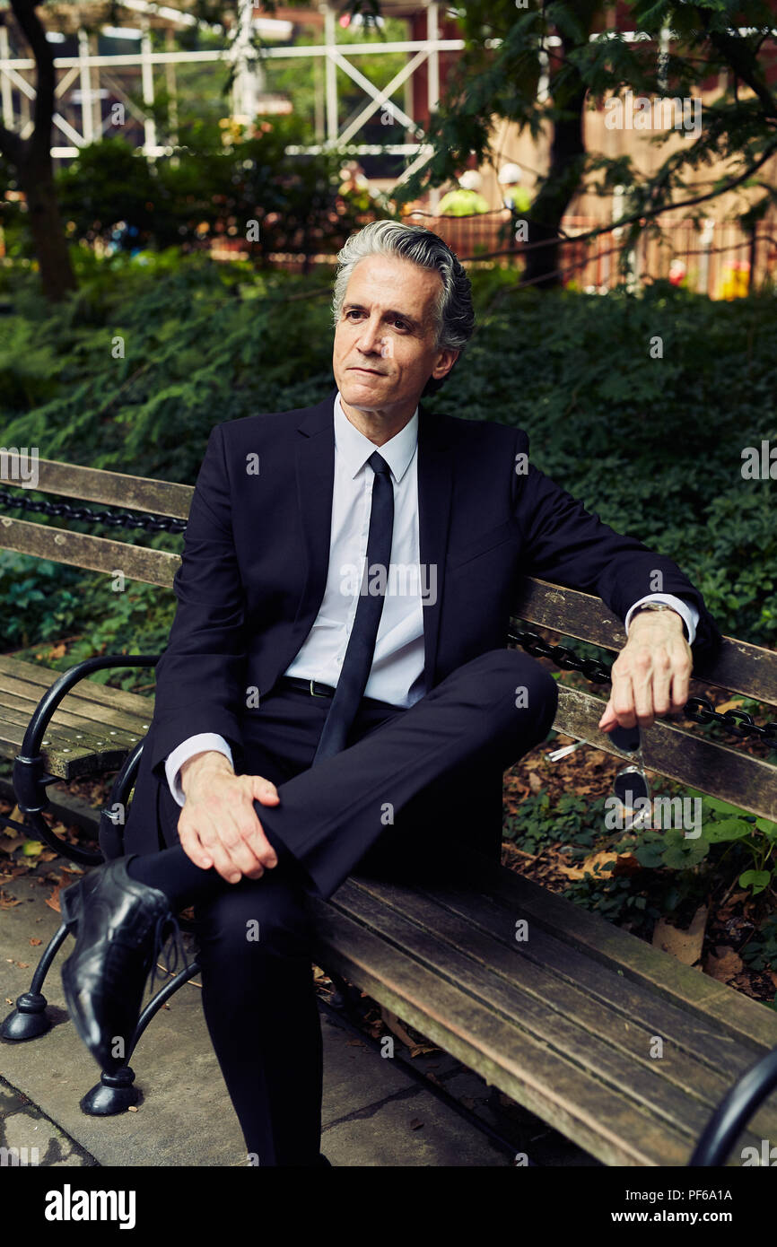 Super Grey Haired Man In Black Suit Sits On Park Bench Stock Photo Evergreenethics Interior Chair Design Evergreenethicsorg