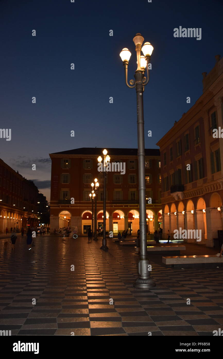 Night time in the Place Massena in Nice France with lighted art - Stock Image