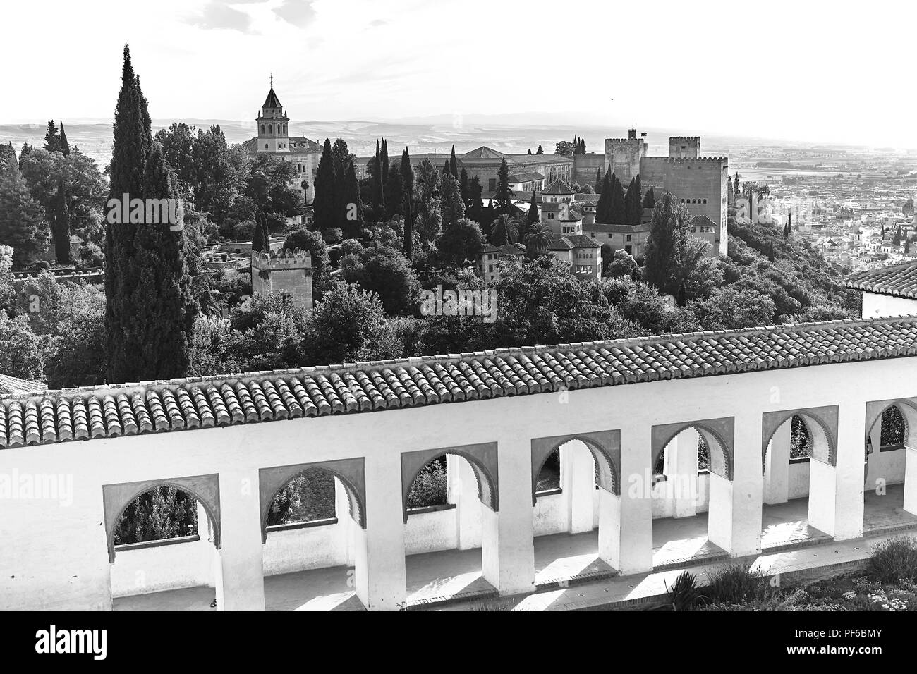 Black and white view across the cityscape of Granada from the Generalife Gardens in Andalusia Spain Stock Photo
