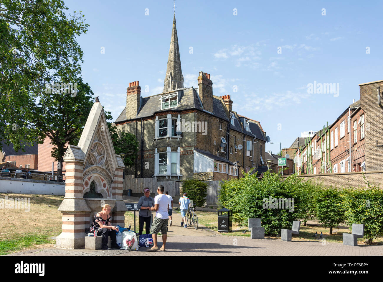 Dyce Drinking Fountain and spire of St Leonard's Church, Streatham Green, Streatham, London Borough of Wandsworth, London, England, United Kingdom - Stock Image