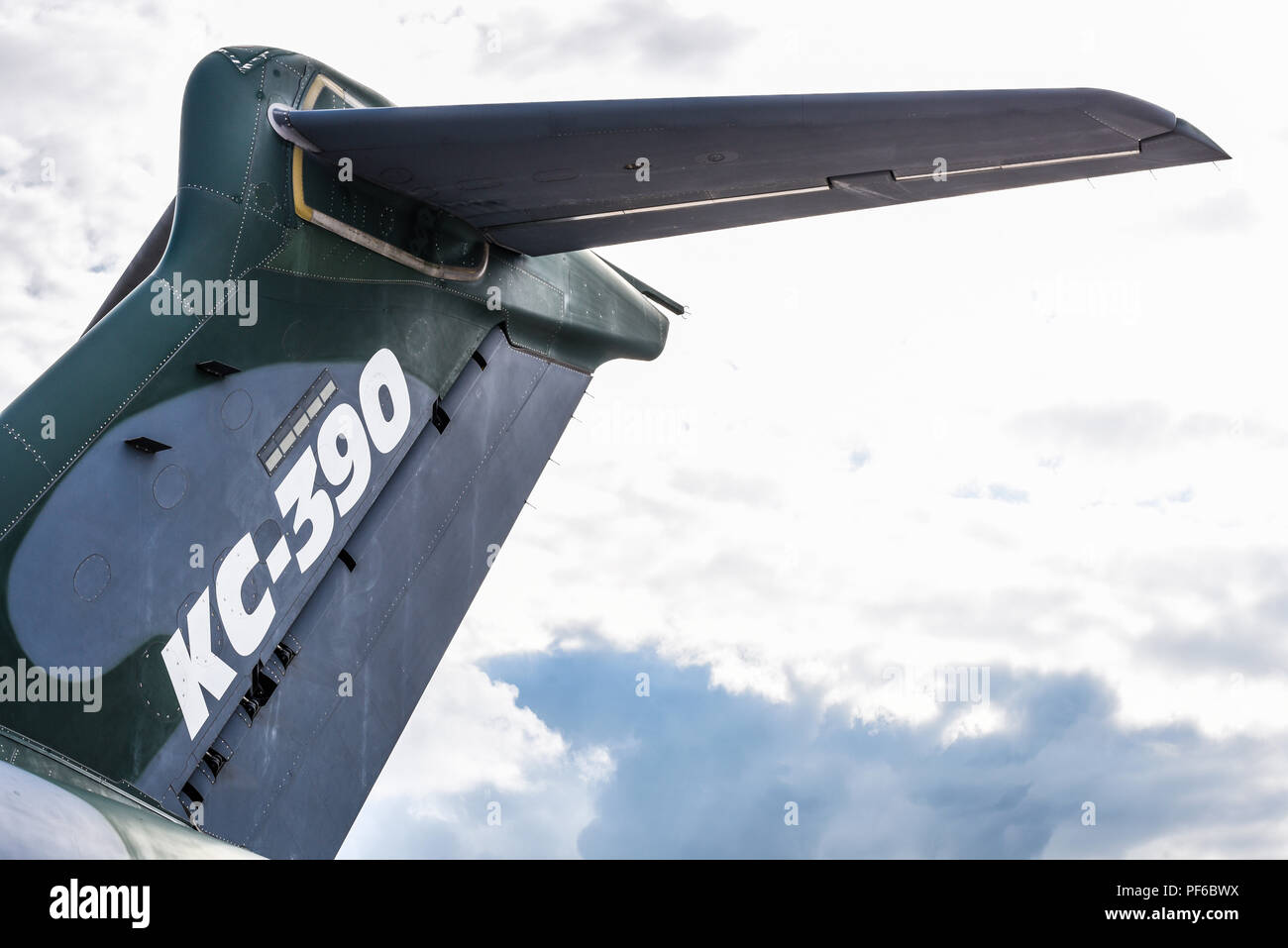 Embraer KC-390 transport jet plane at the Farnborough International Airshow FIA, aviation, aerospace trade show. High tail. Space for copy - Stock Image