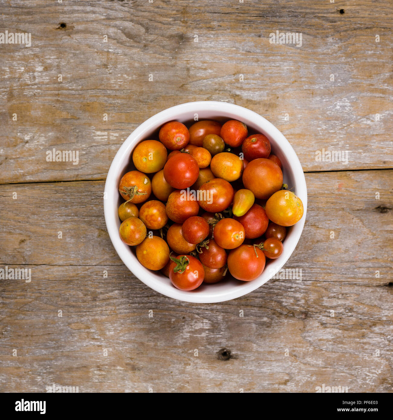 You could use this bowl of tomatoes to help you communicate with plenty of room to overlay some text across the 'Board' - Stock Image